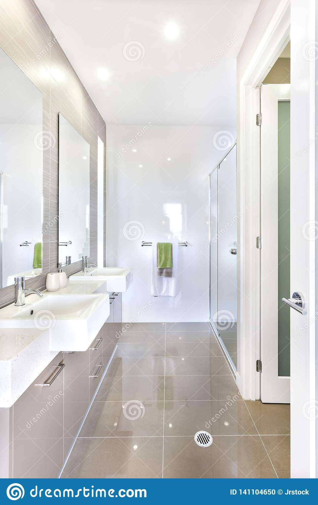 Modern bathroom with set of washstands and bathroom