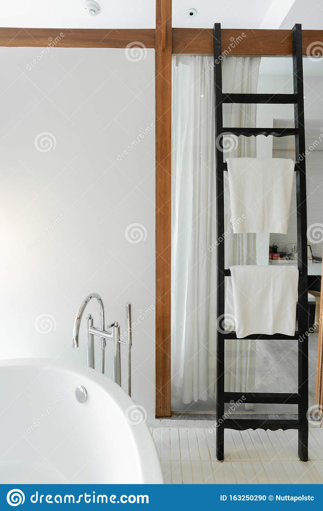 Modern Bathroom In Modern Style With Empty White Painted Wall And Black Wooden Ladder Towel Rack In Tropical Resort Copyspace Stock Photo Image Of Copy Chrome 163250290