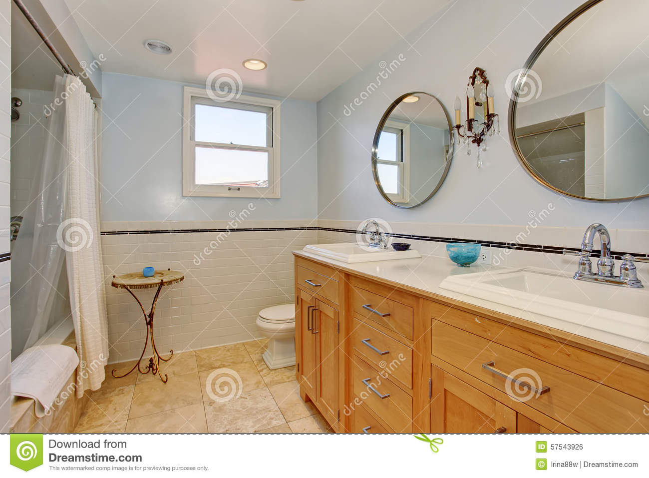 Modern Bathroom With Two Oval Mirrors And White Shower Curtain