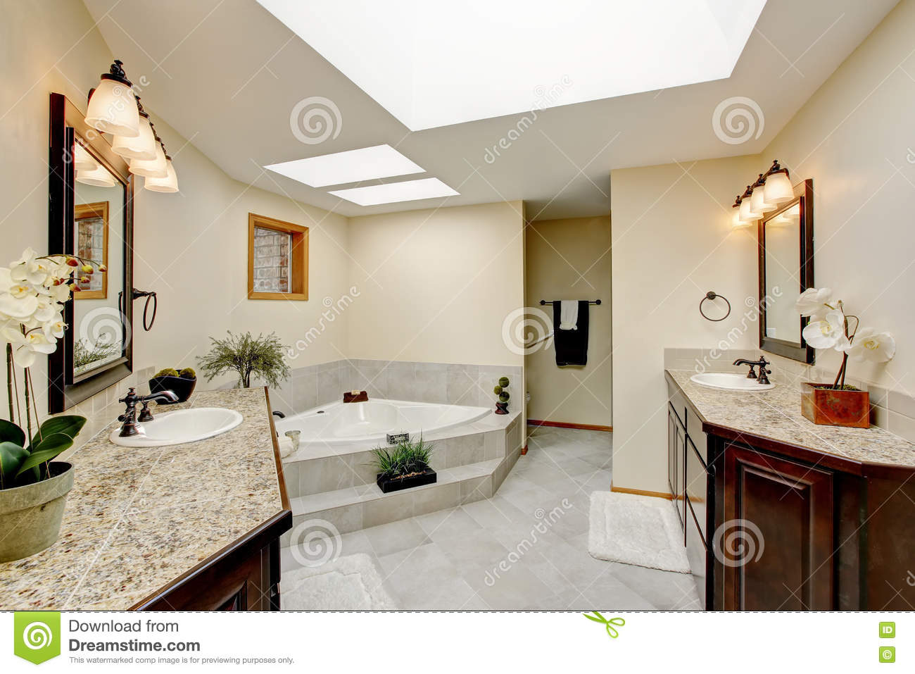 Modern Bathroom With Two Vanity Cabinets With Granite Counter Top ...
