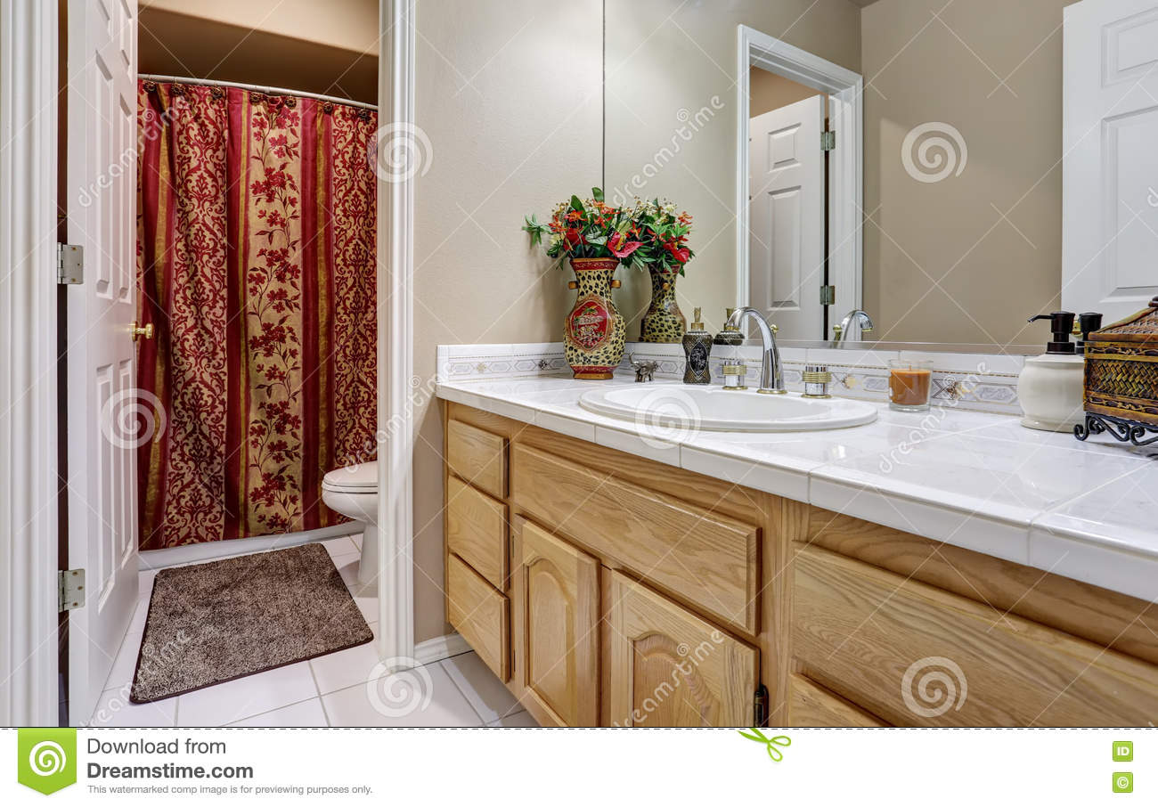 Modern Bathroom Vanity Cabinet With Large Mirror View Of Bright Red Shower Curtain Northwest USA