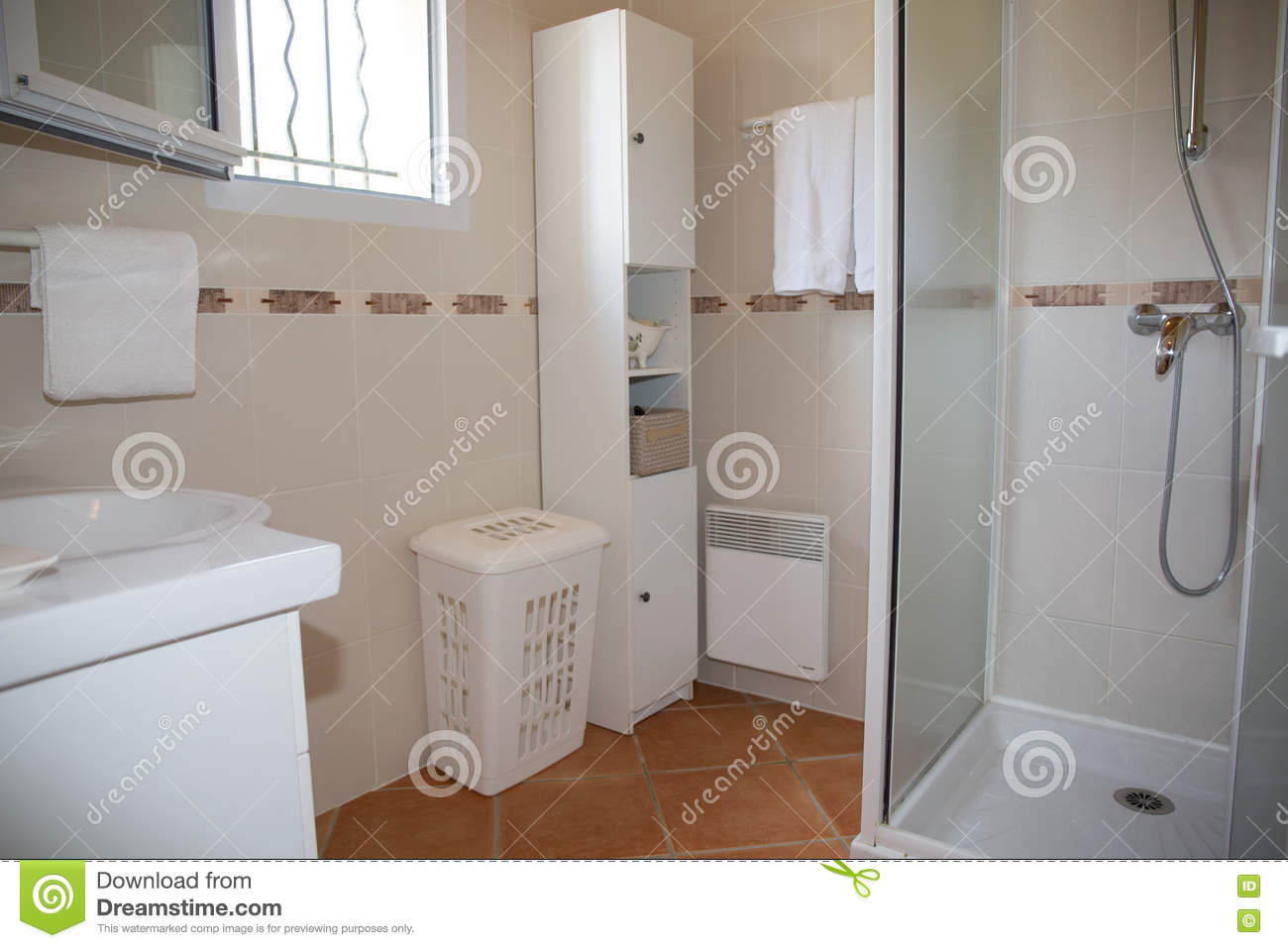 Modern Bathroom With White Ceramic Appliances And Shower Cabin Stock ...