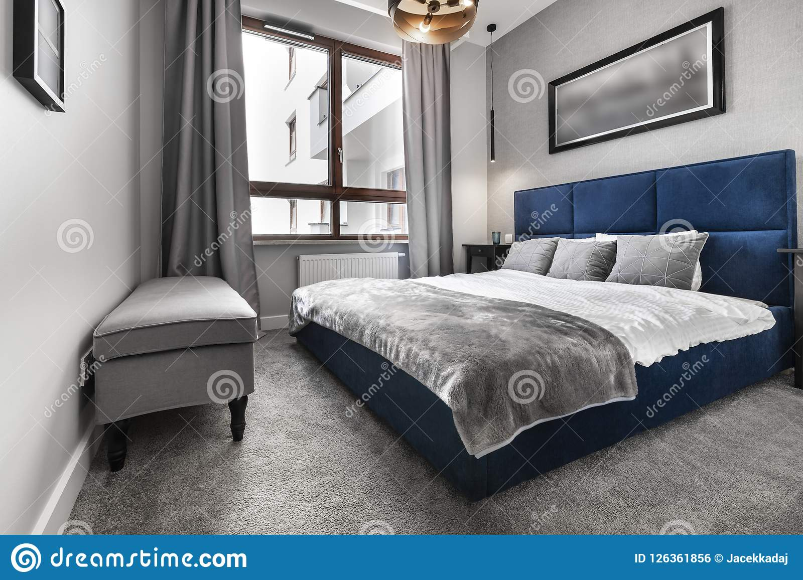 Modern bedroom with blue bed