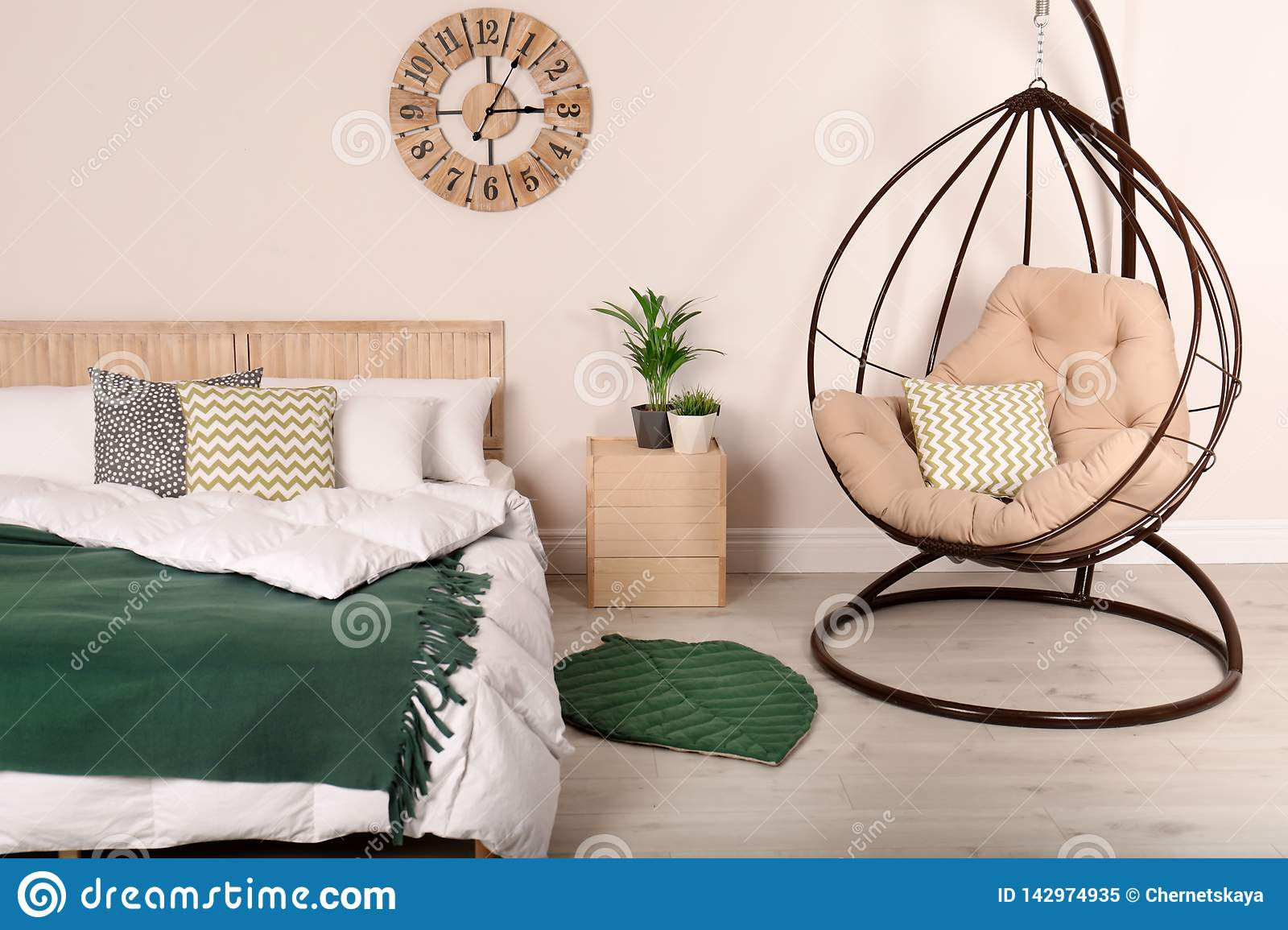 Modern Bedroom Interior With Comfortable Hanging Chair Stock