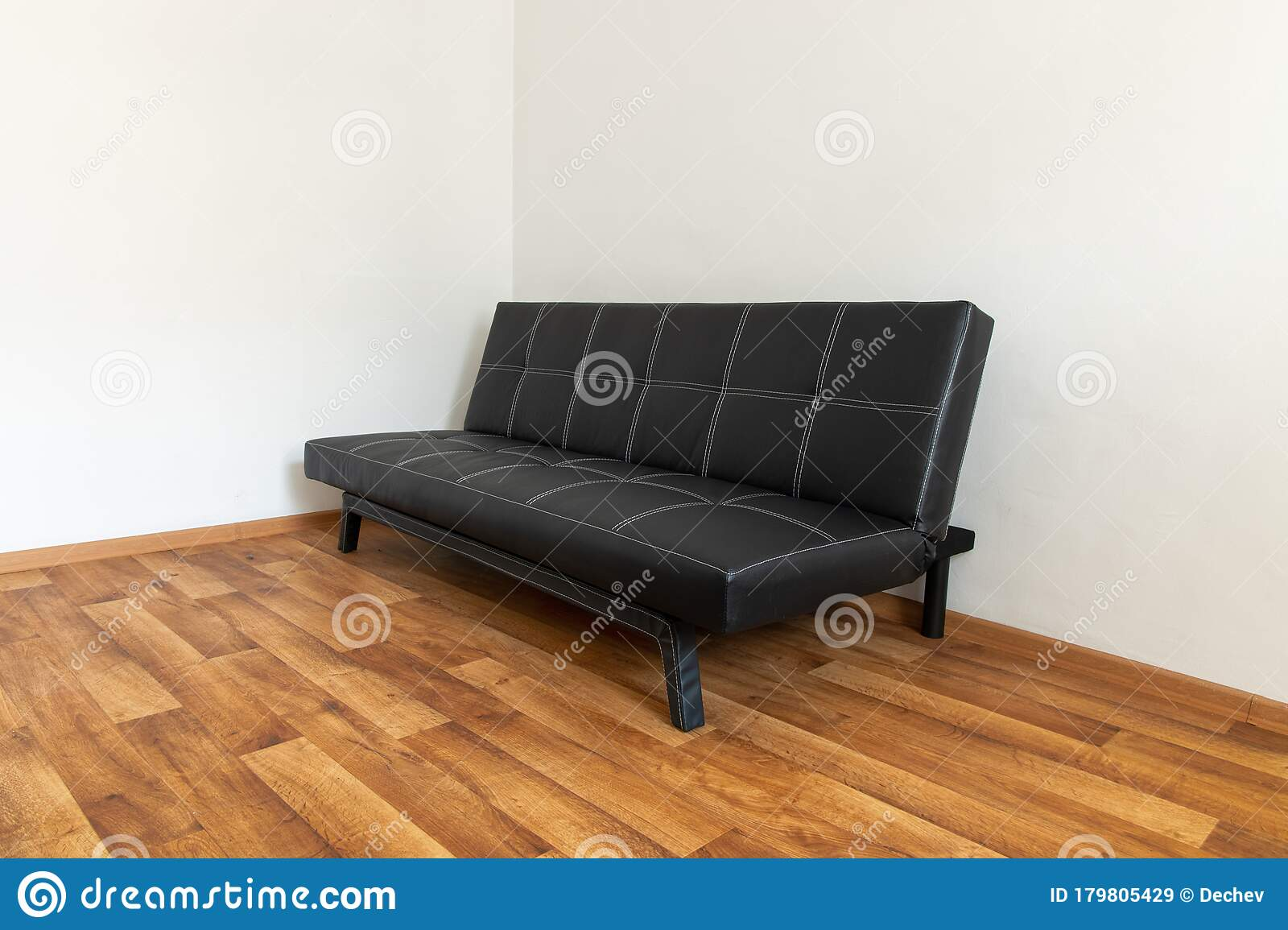 Modern Black Leather Convertible Sofa Bed Wooden Floor Empty Waiting Room With A Modern Black Sofa Stock Image Image Of Residential Clean 179805429