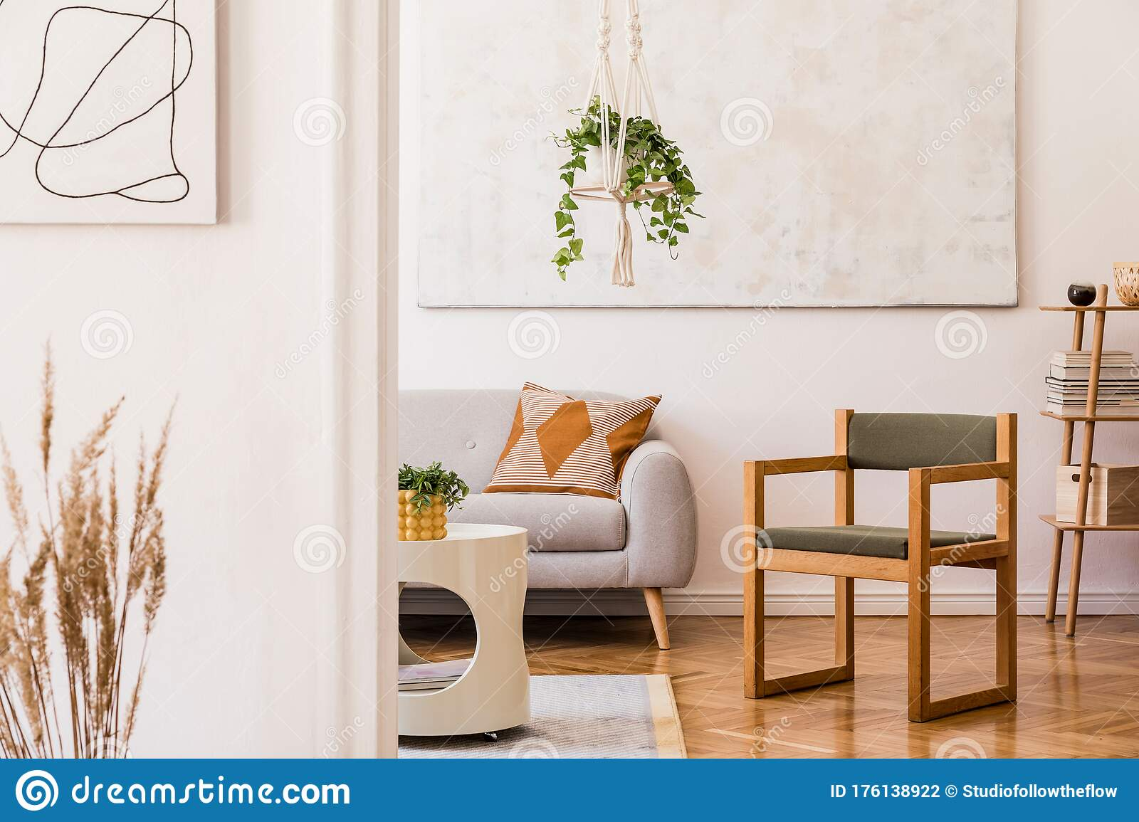 Modern Boho Interior Of Living Room At Cozy Apartment With Grey Sofa And Wooden Armchair Stock Photo Image Of Decor Modern 176138922