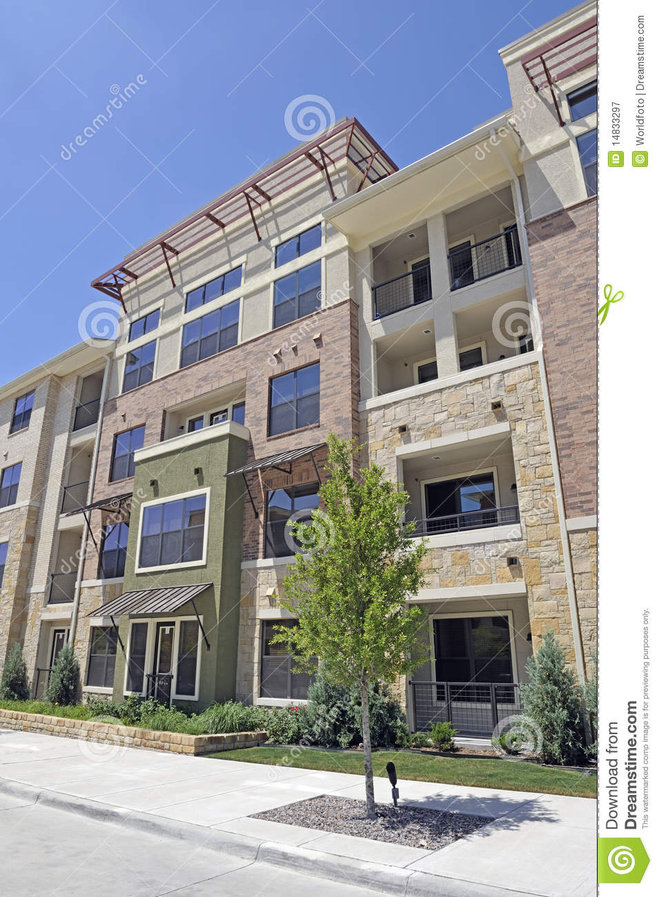 Modern brick apartment building exterior in full sun Brick Apartment Building