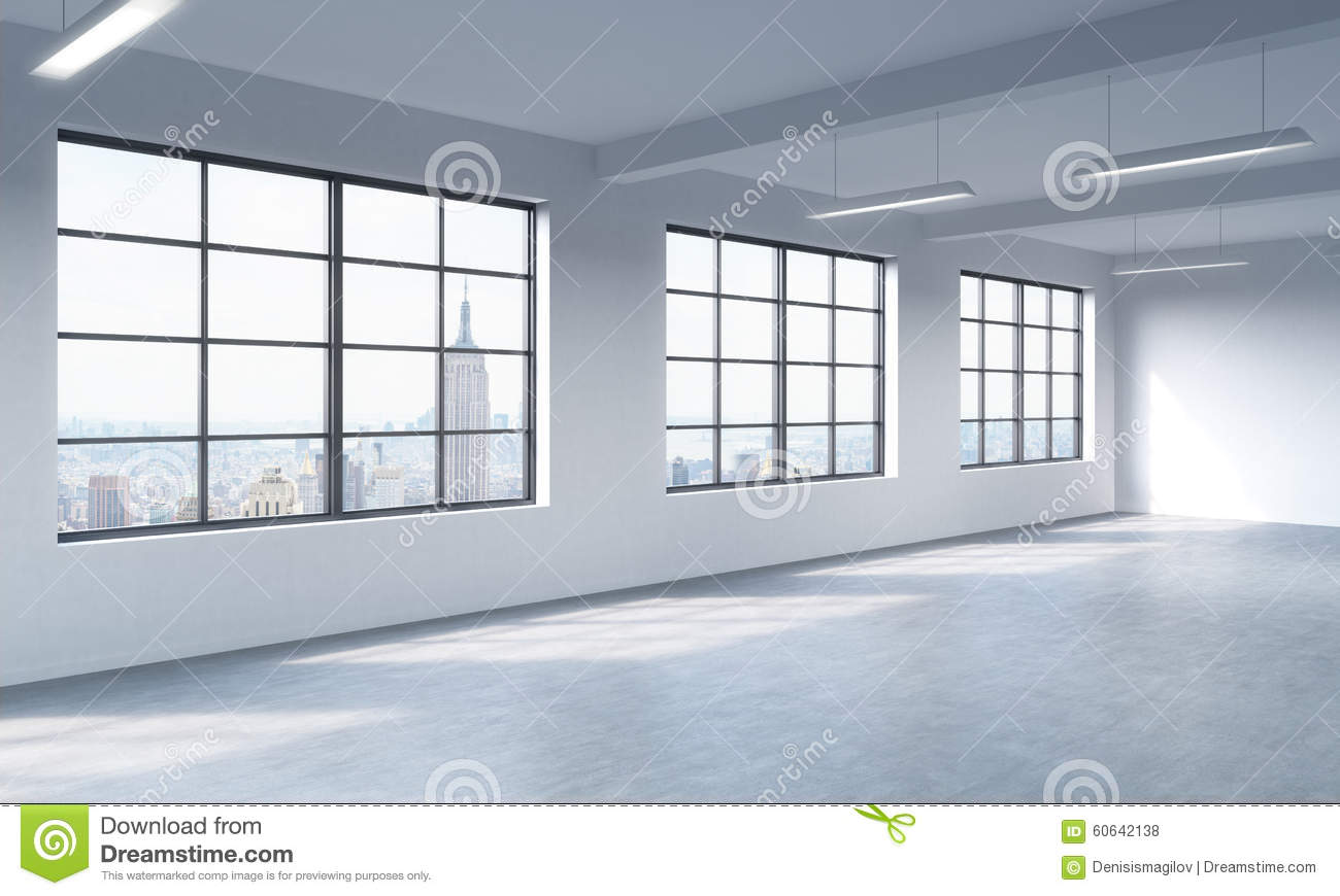 Modern bright clean interior of a loft style open space. Huge windows and white walls. New York panoramic city view.