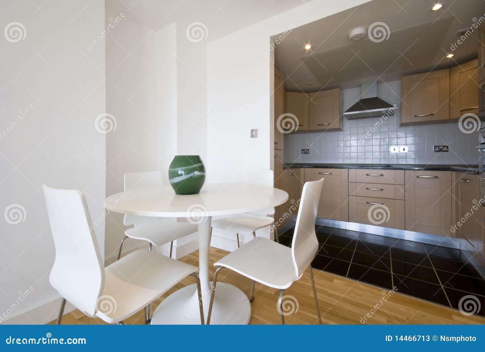 Modern bright kitchen with dining corner