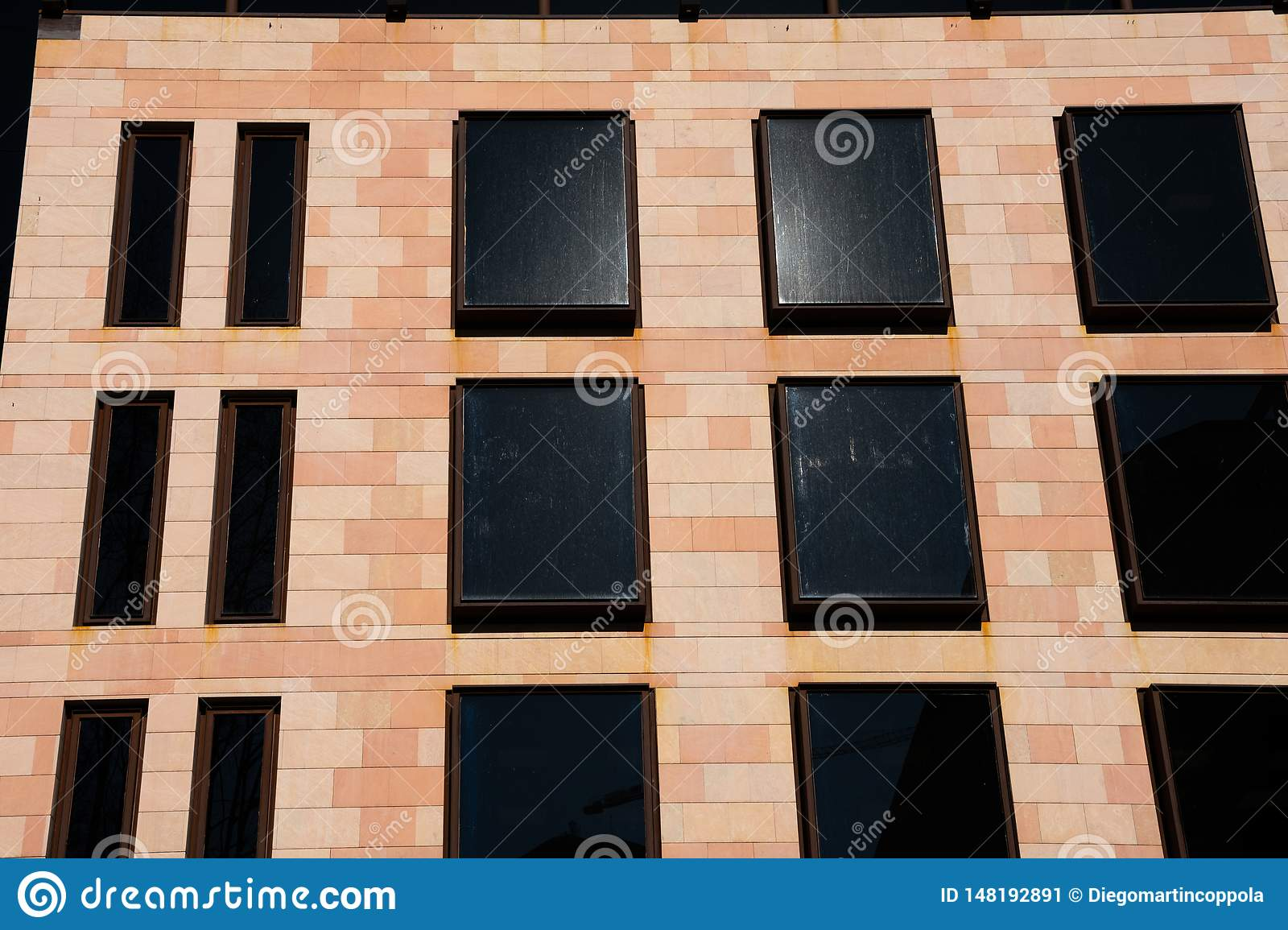 Modern building facade with black glass windows