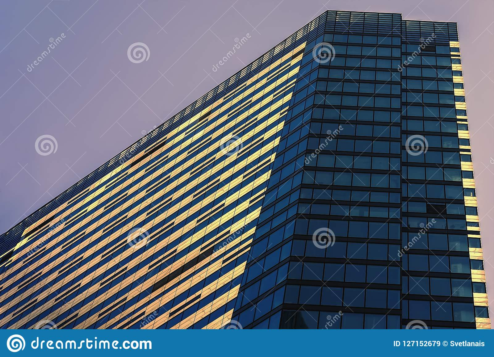 Modern building from glass and concrete, business district, abstract background, geometric city abstract