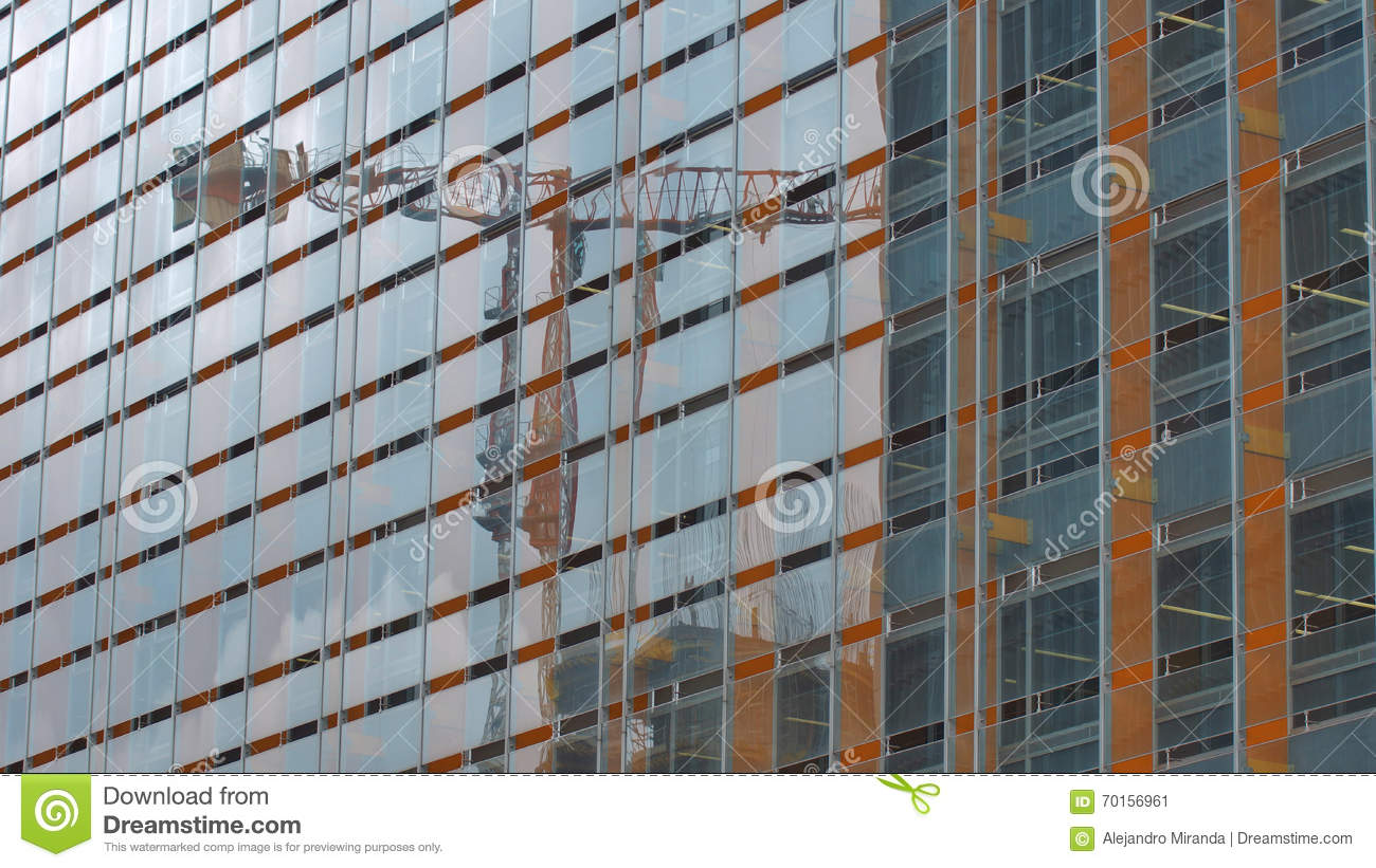 Modern Building With Glass Windows Reflected Sky And Construction ...