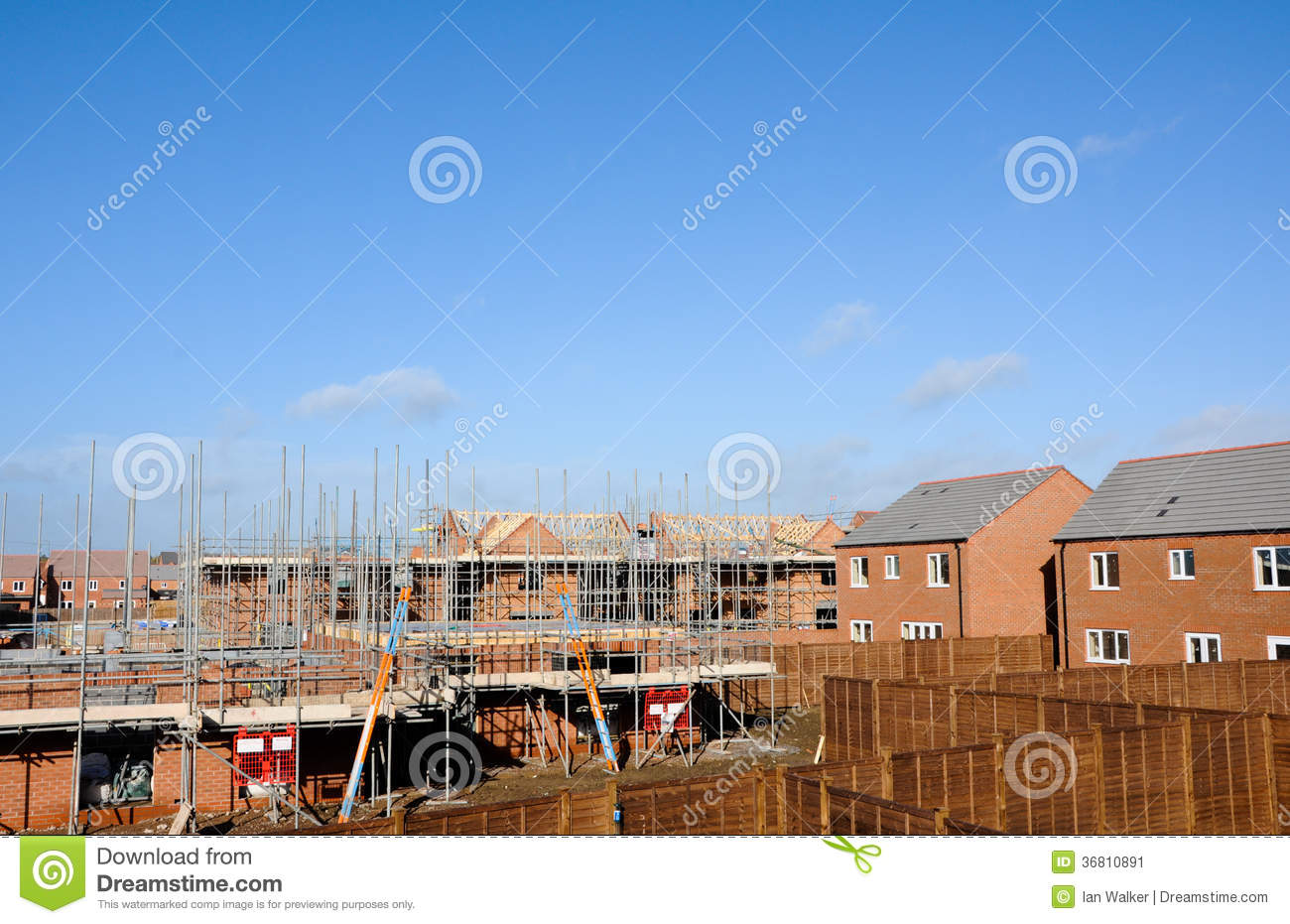 Modern building site constructing modern homes stock for Modern building construction