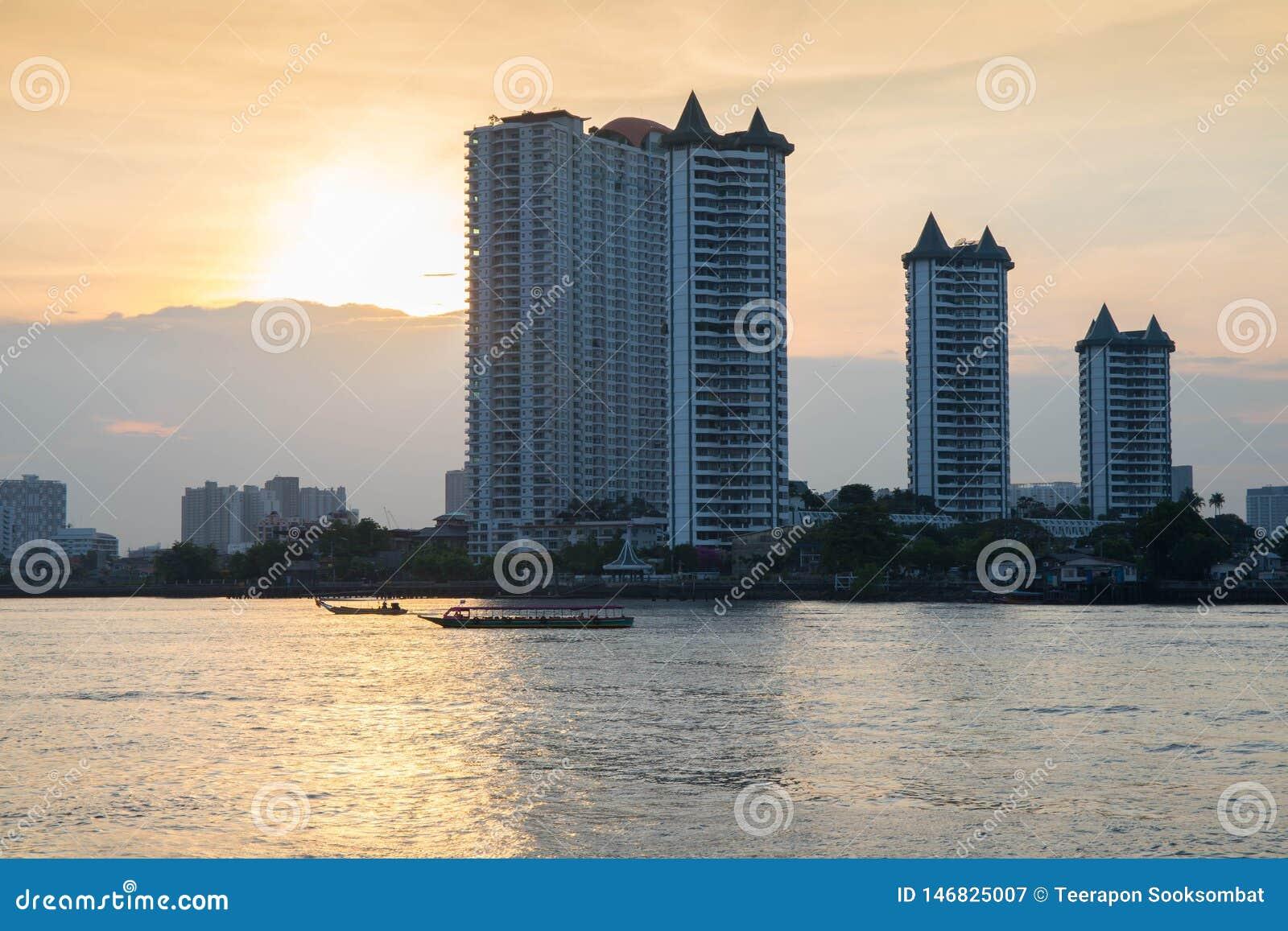 Modern buildings condominium at Chao Phraya River Bangkok Thailand at sunrise