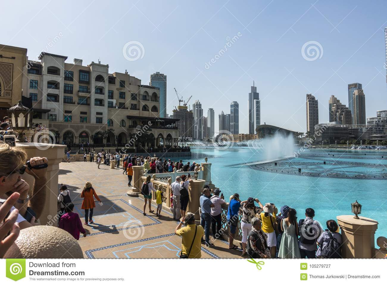 Crowd gathers around the dubai mall fountain to see the water show.