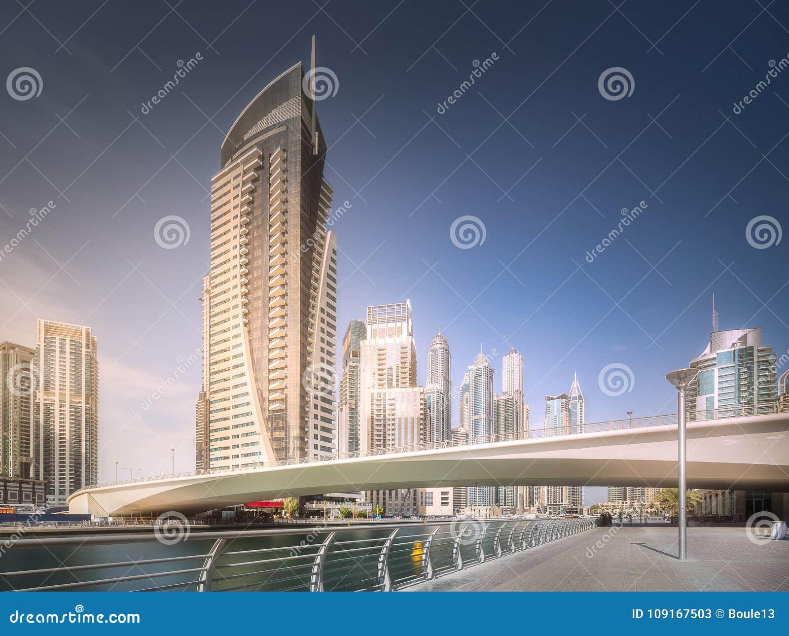 Day view of Dubai Marina bay with bridge, UAE