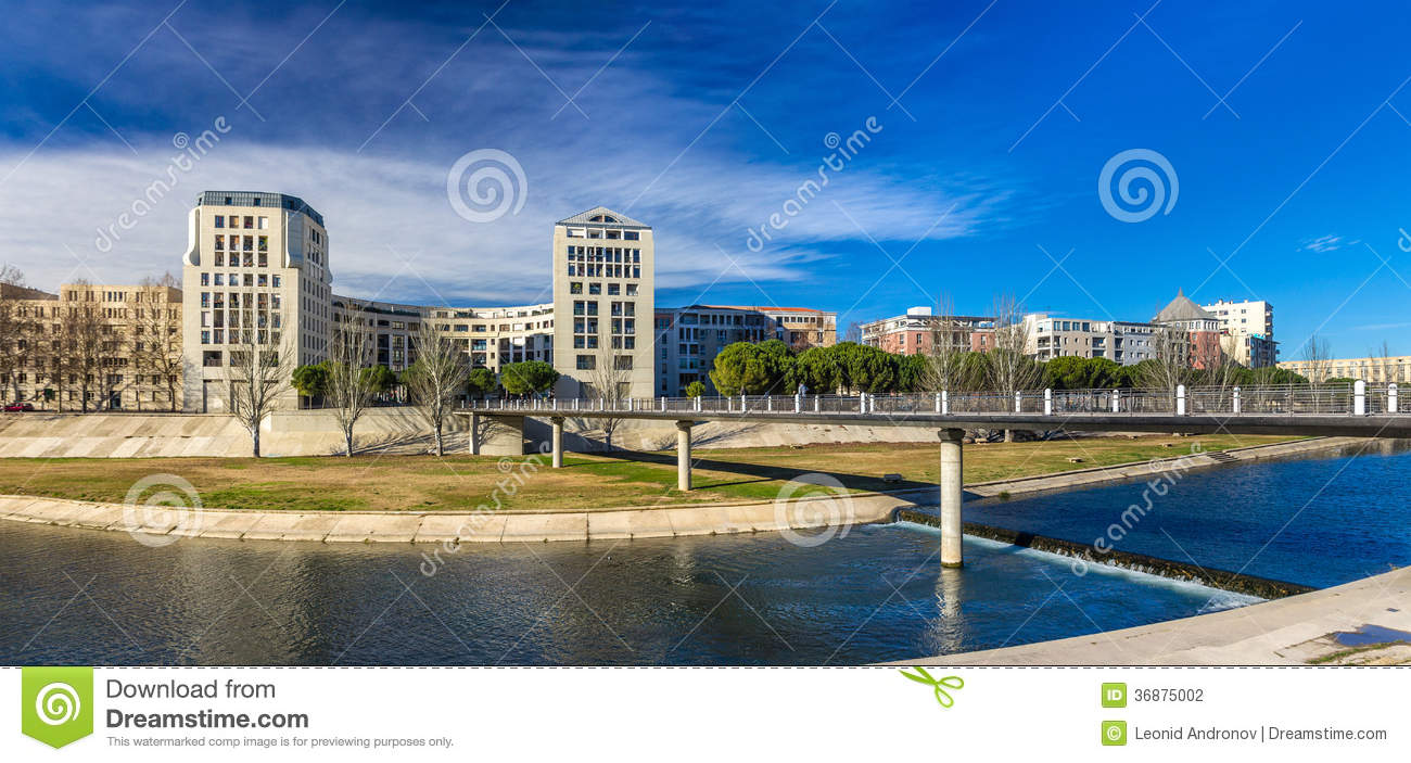 Modern buildings in Montpellier by river Lez - France