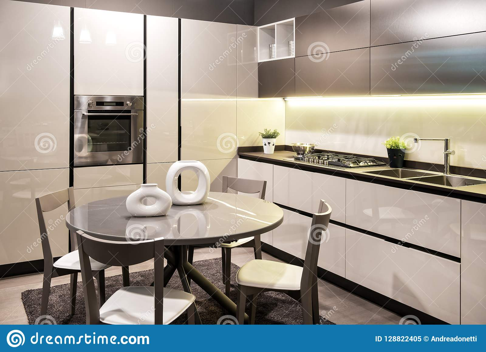 Modern Built In Kitchen With Circular Dining Table Stock Image Image Of Sink Appliances 128822405