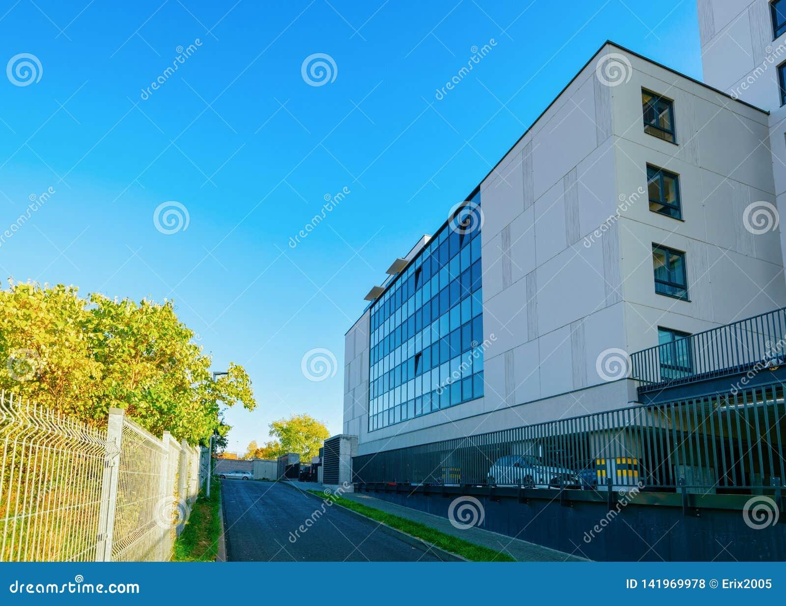 Modern business corporate office building car parking Blue sky