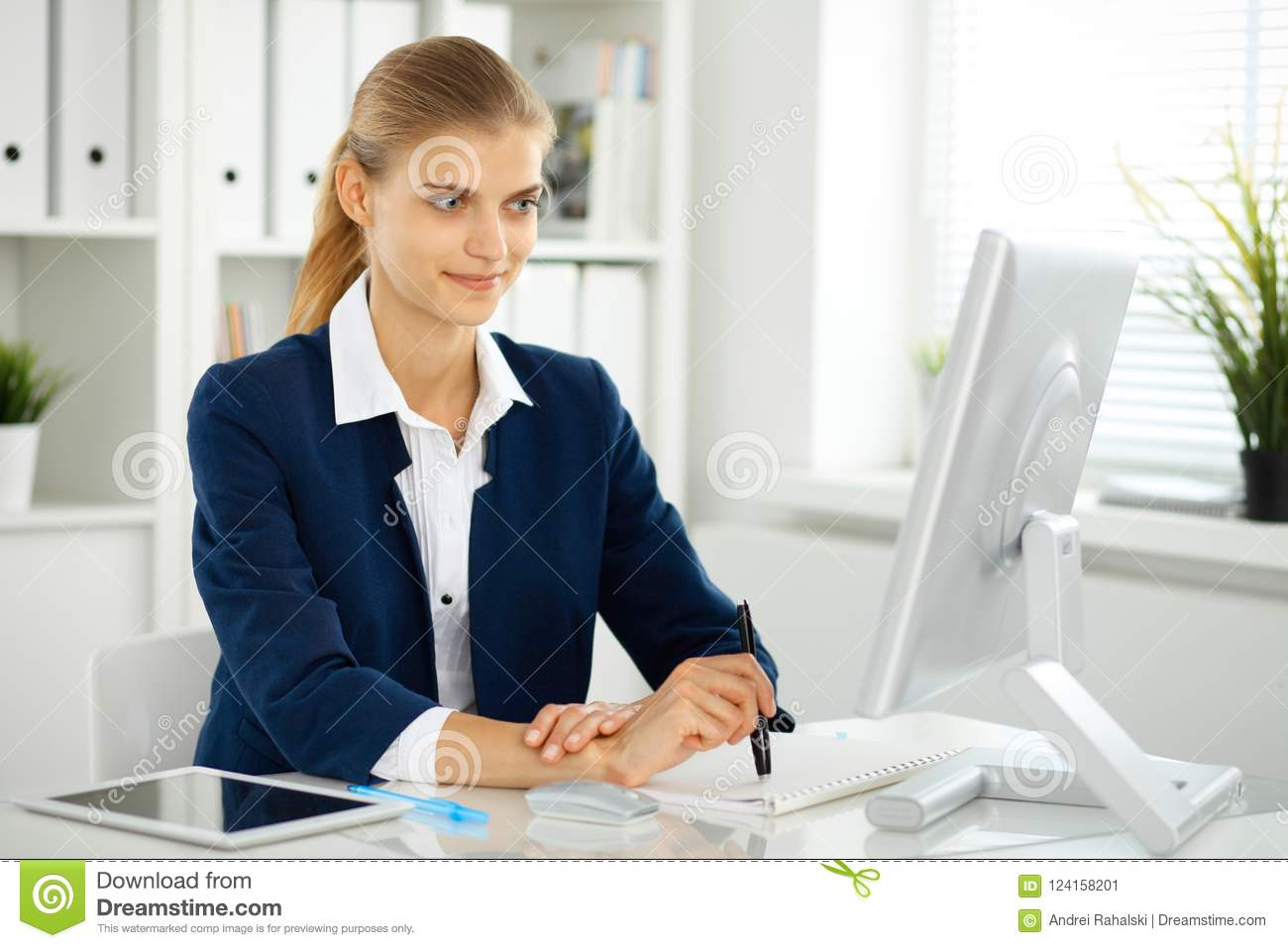 Modern business woman or confident female accountant in office. Student girl during exam preparing. Audit, tax service