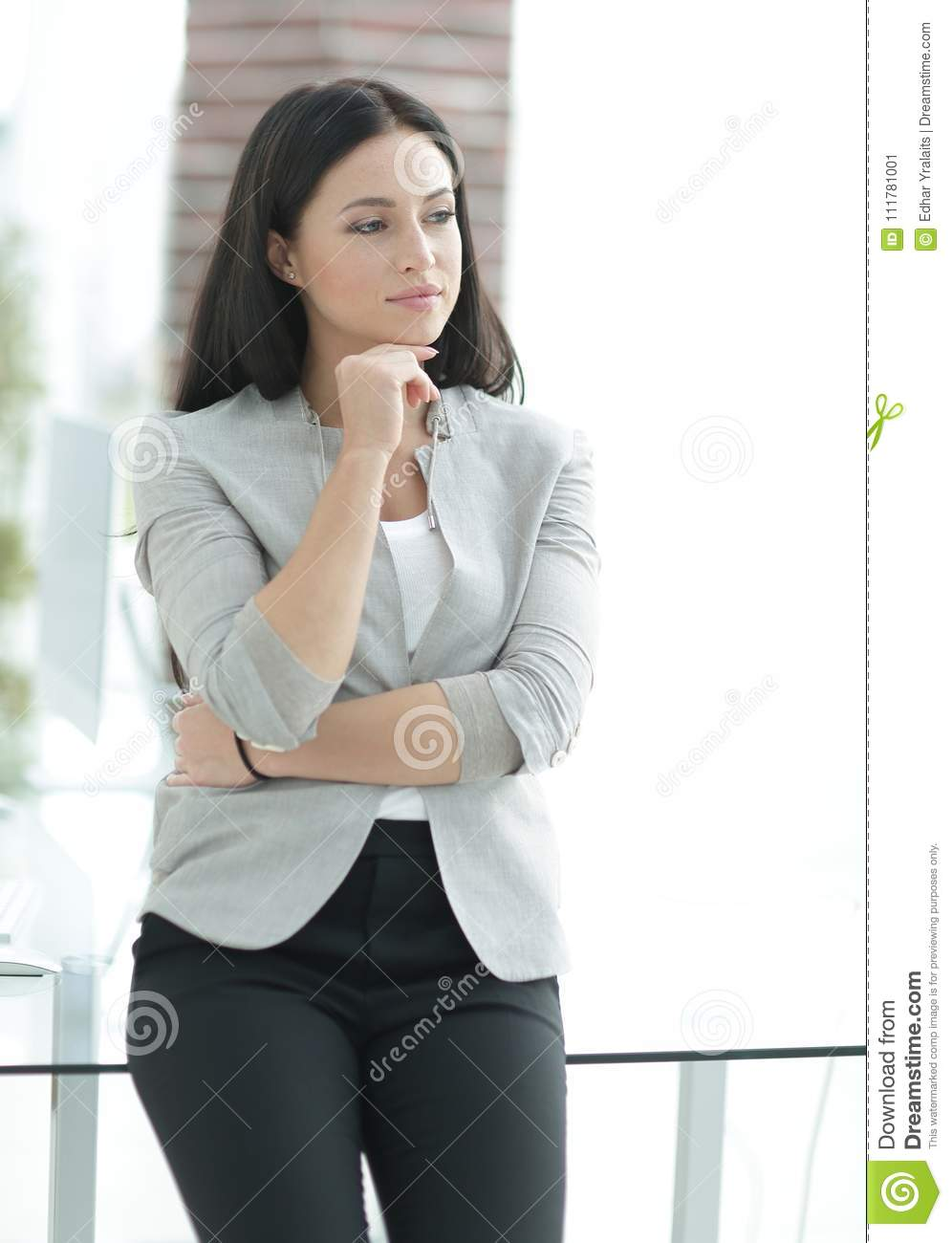 Modern business woman near the window in the office