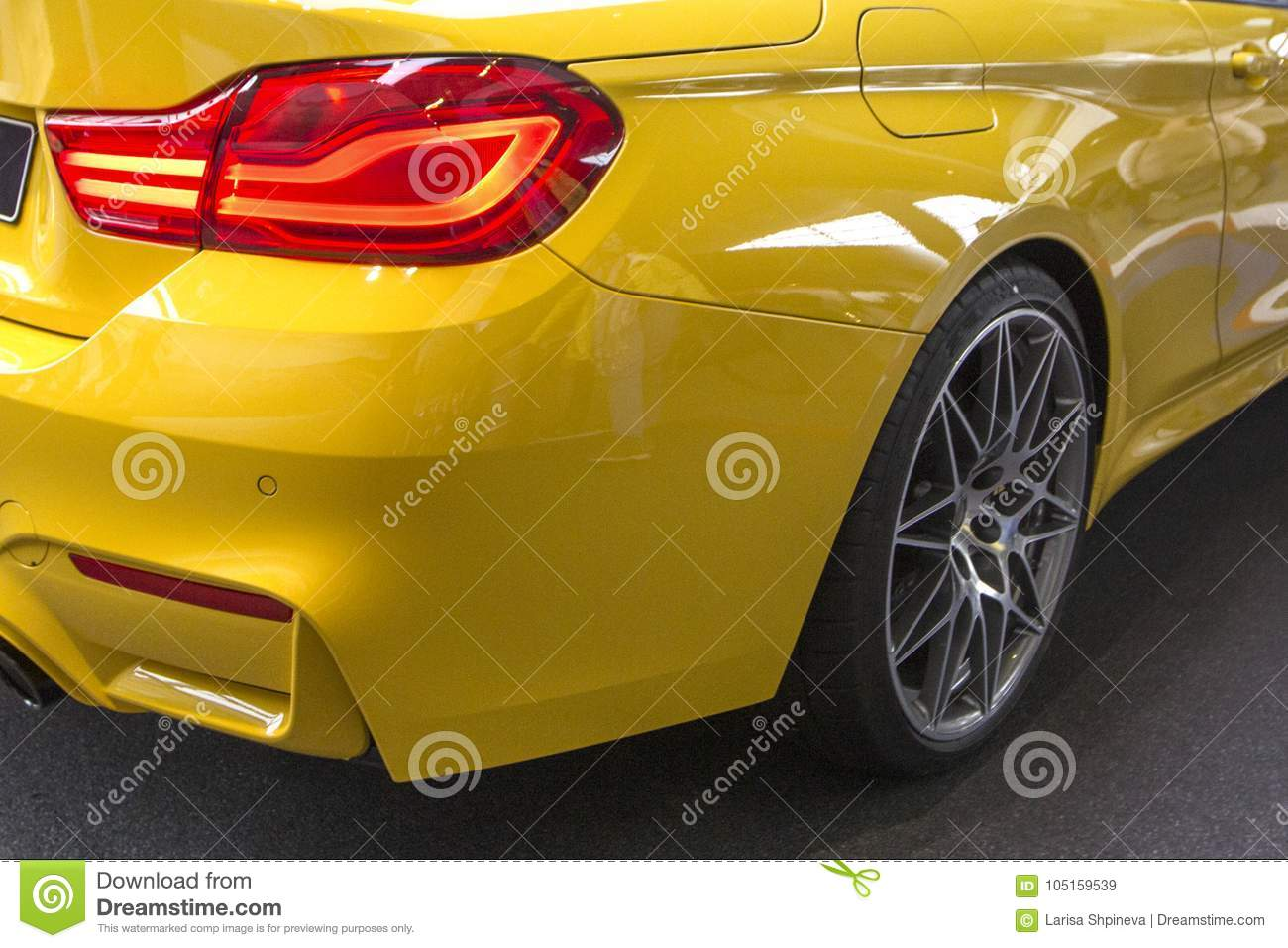 Modern Luxury Yellow Car Back Headlights Closeup Concept Of