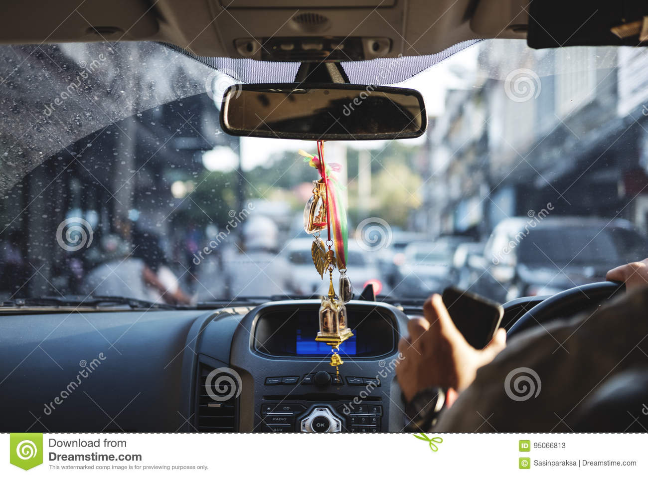 Car interior hanging - Modern Car Interior With Hanging Amulets Charm On Rear View Mirror Driving On The Road Selective Focus