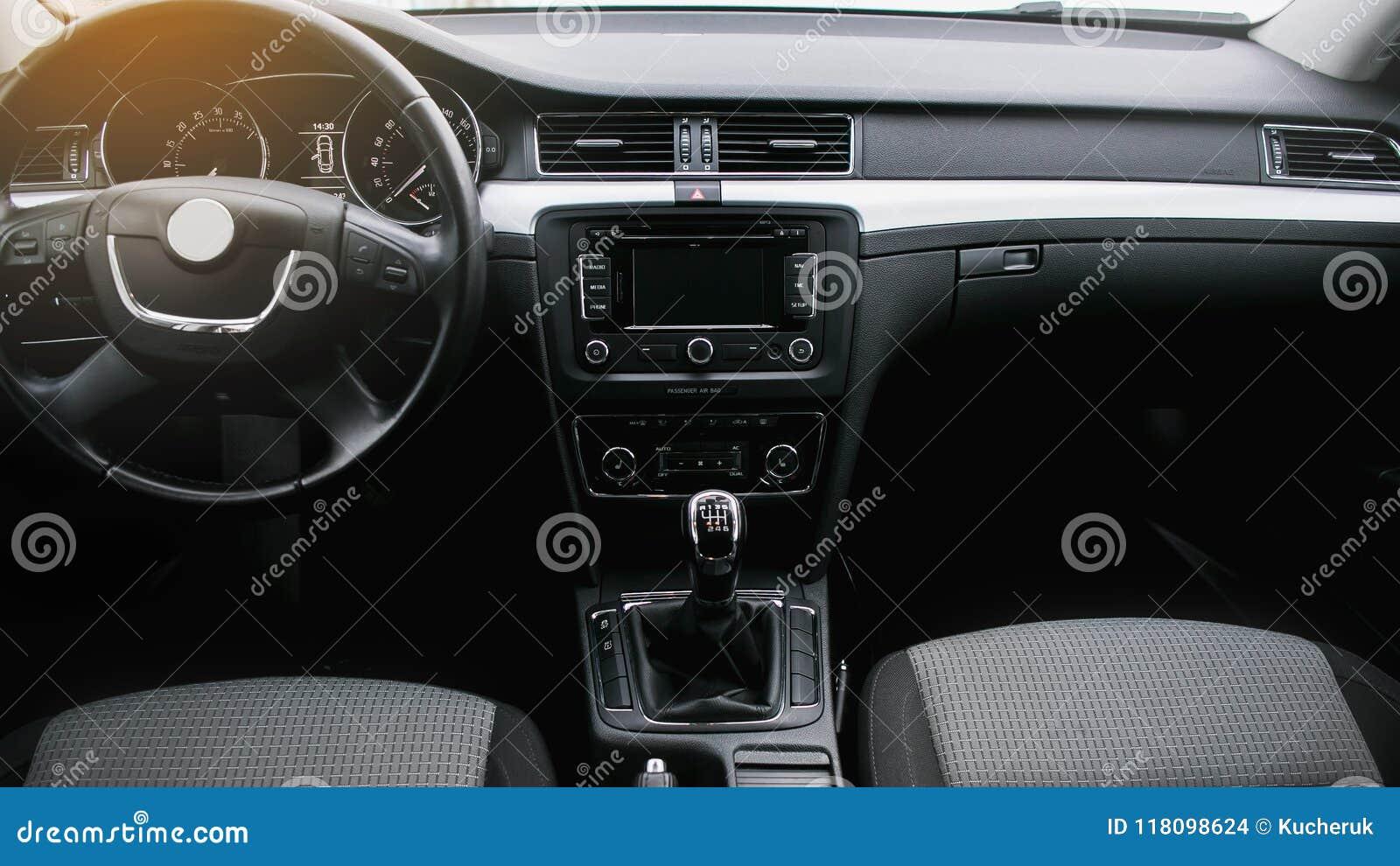 Modern car interior. Steering wheel, dashboard, speedometer, display.