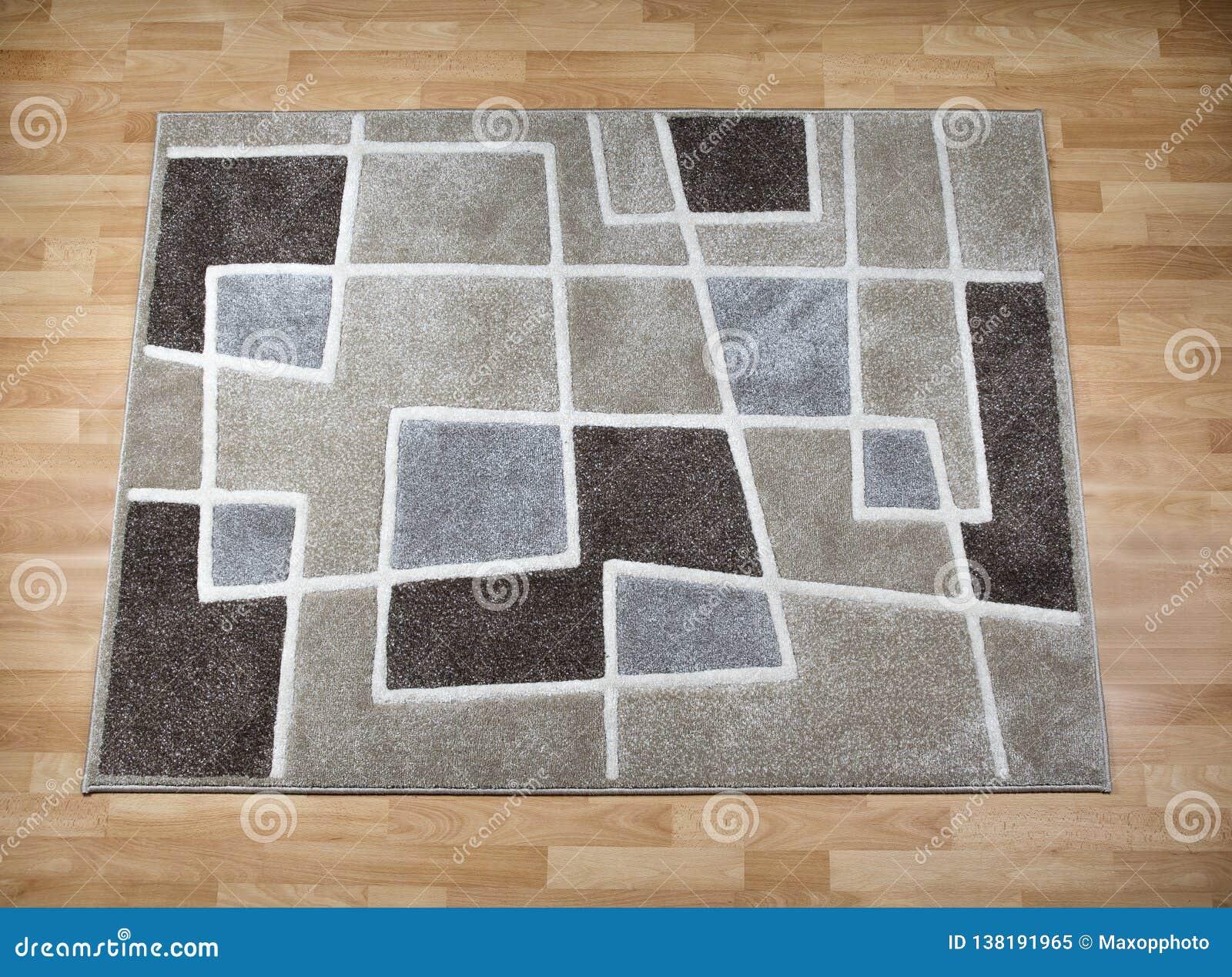 Modern carpet on laminate parquet floor