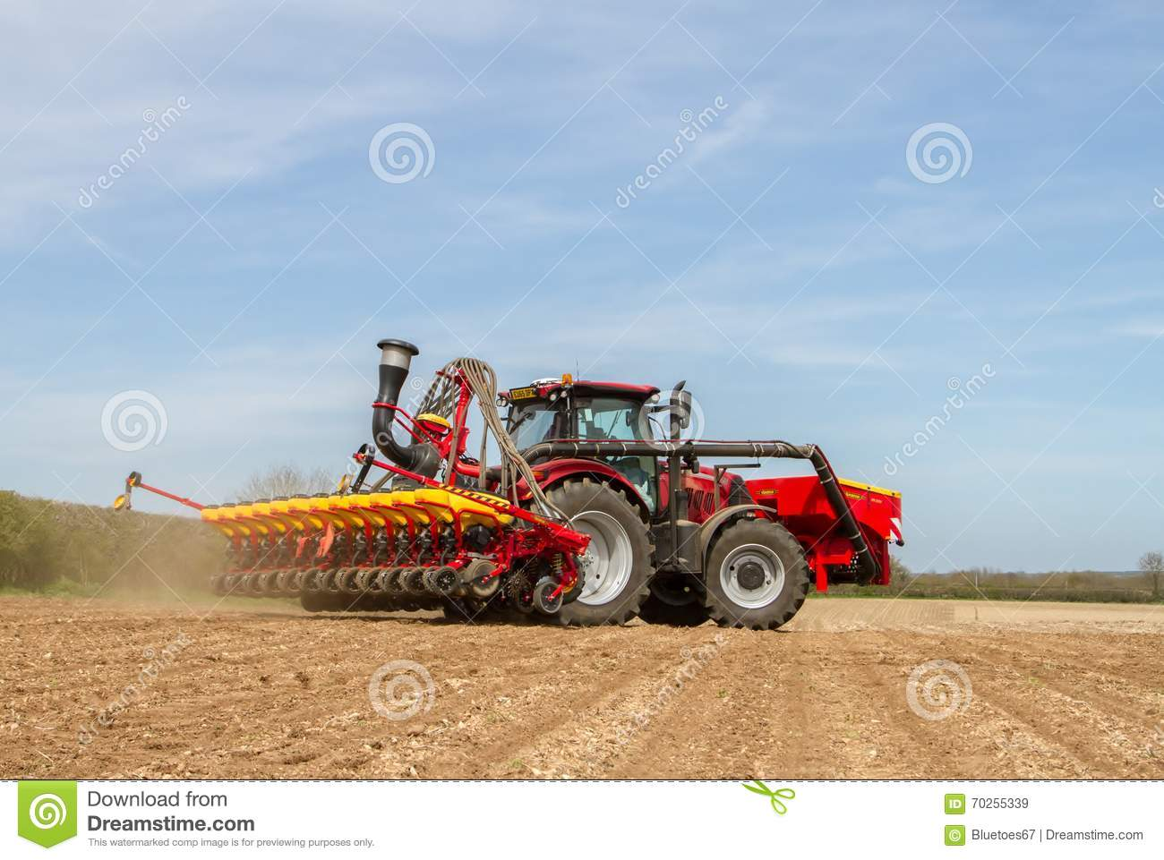 Tractor In Field Planting : Modern case tractor drilling seed in field editorial stock