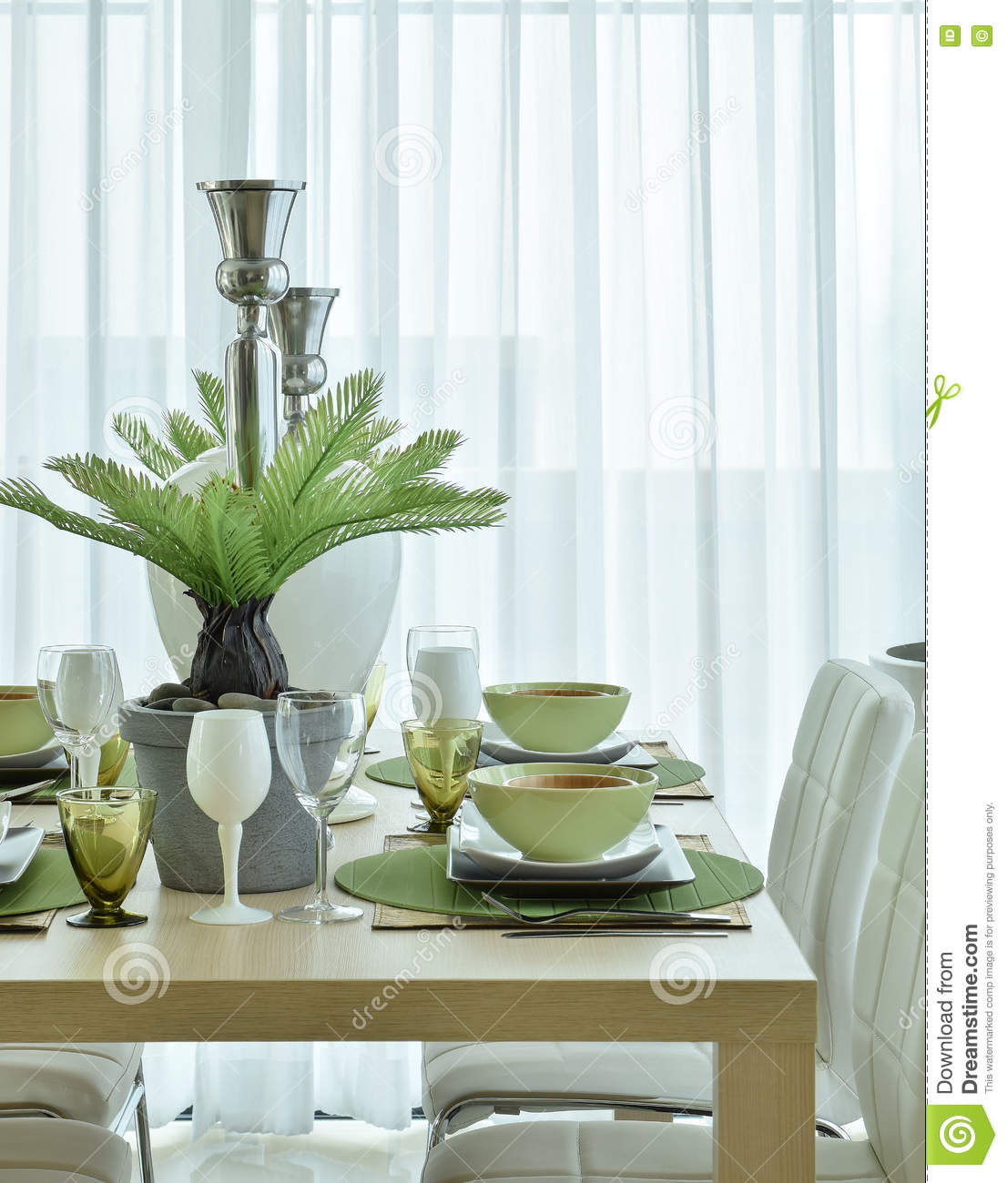 Modern Ceramic Tableware In Green Color Scheme Setting On Dining Table