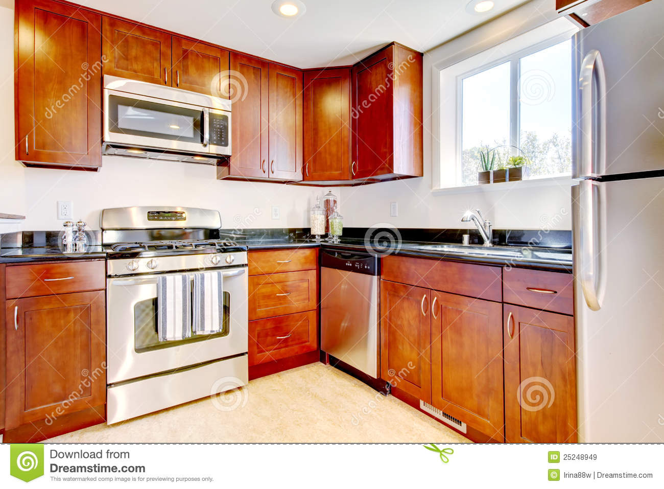 modern cherry kitchen with steal appliances royalty free stock images