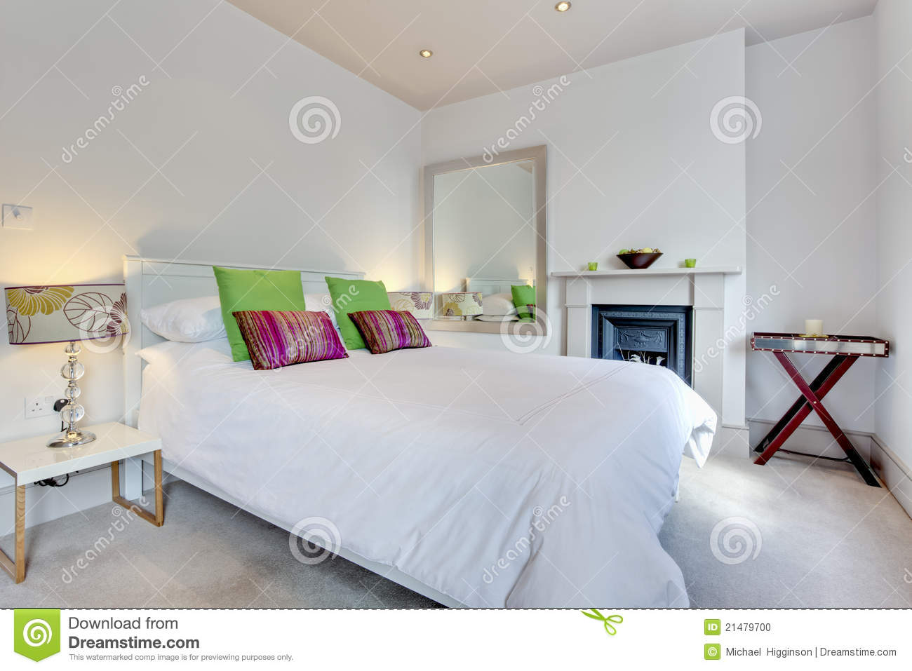 modern chic luxury bedroom with brightly coloured fabrics and
