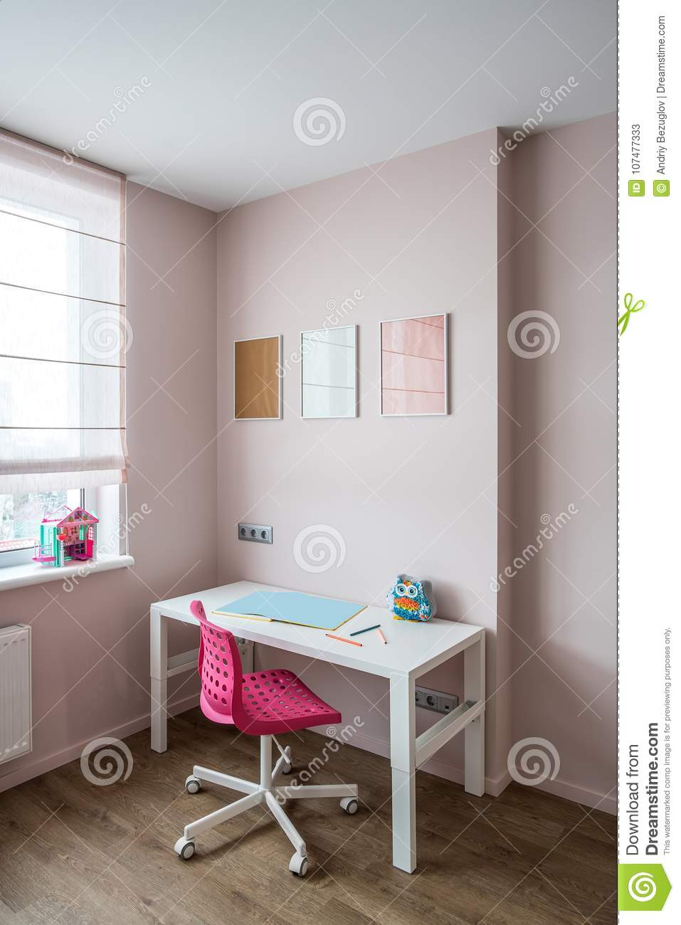 Contemporary children room stock image image of indoor 107477333 modern children room with light pink walls and a parquet on the floor there is a white table with book pencils and a toy and a pink chair aloadofball Image collections