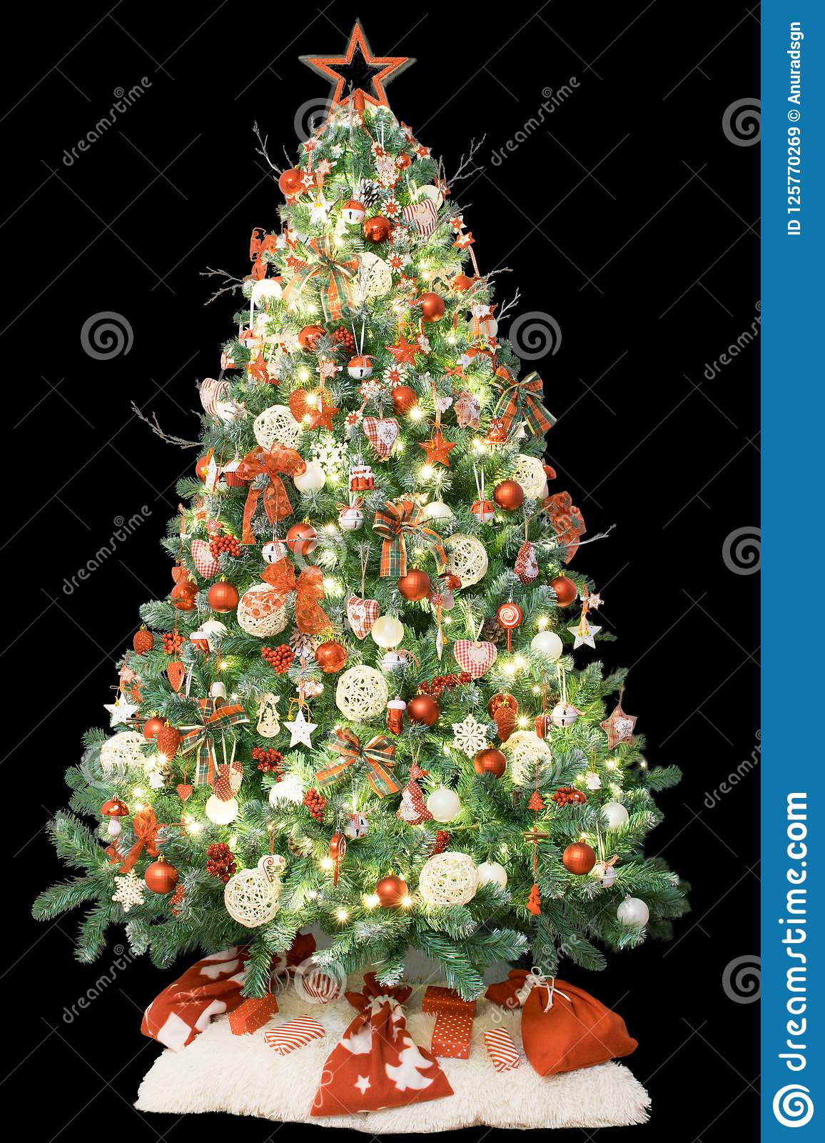 modern christmas tree decorated with vintage ornaments lights and red white gifts isolated