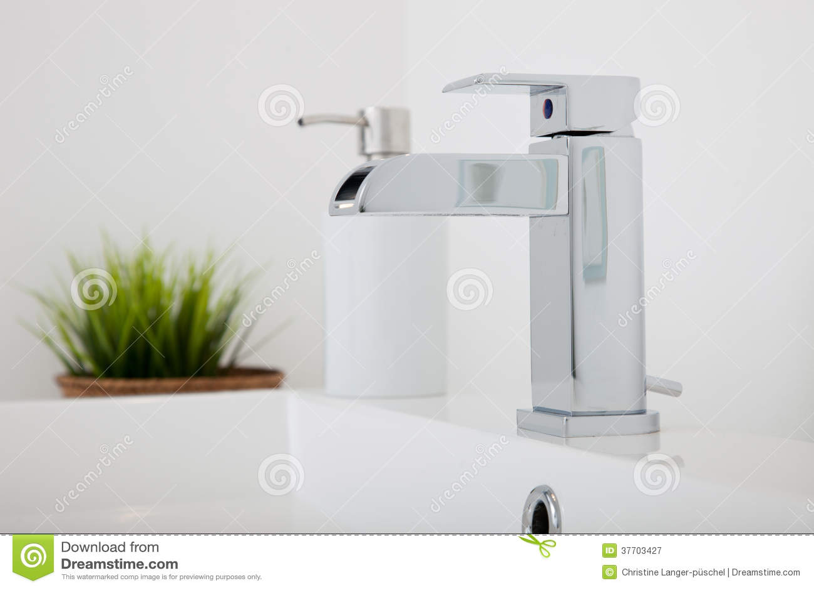 Modern chrome metal tap fitting in a bathroom