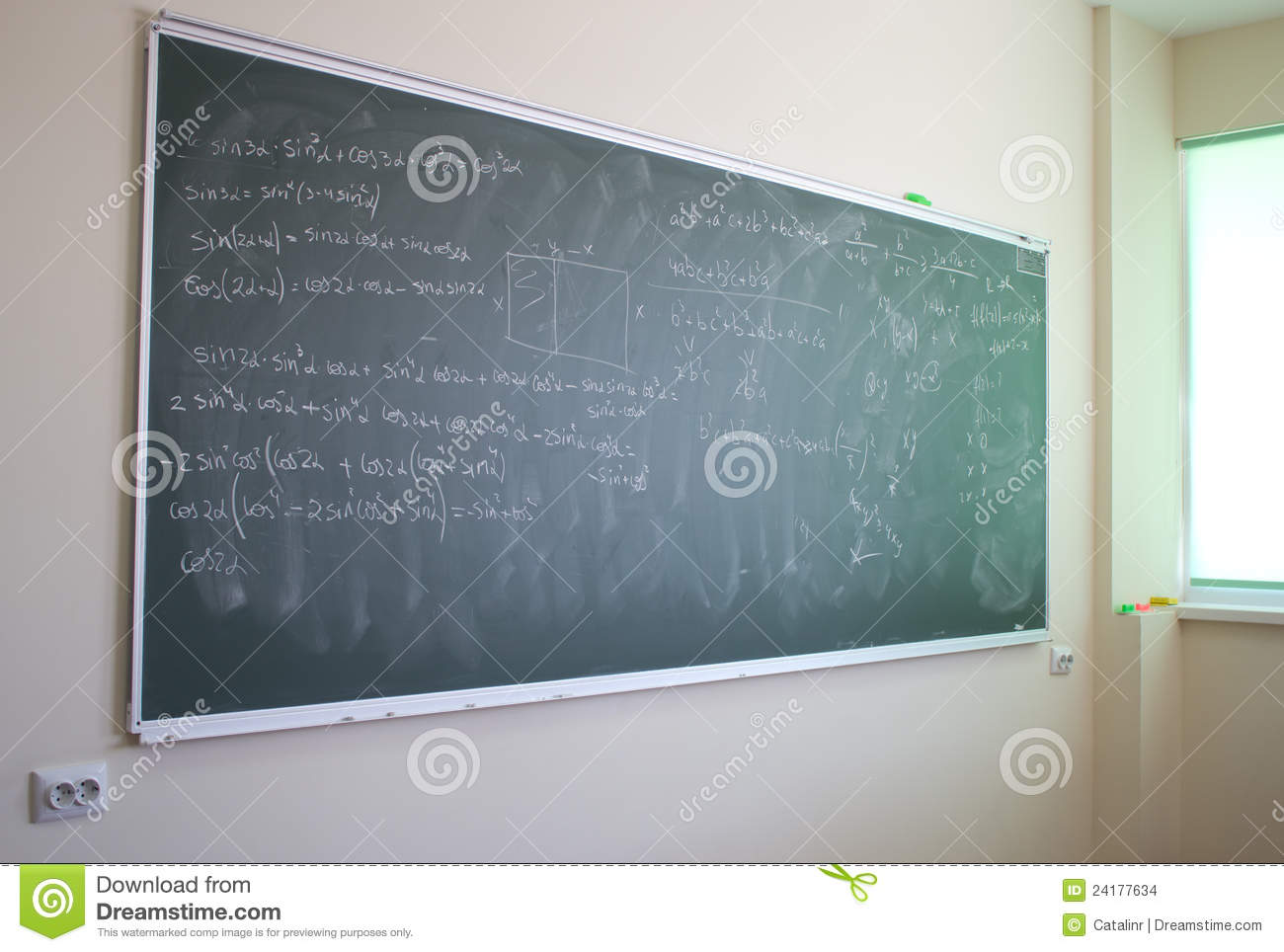 Blackboard with mathematical formulas in a modern classroom.