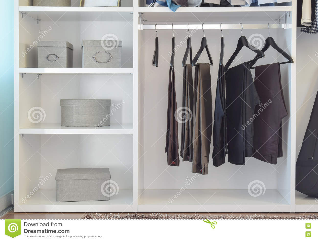 321d45d8fb Modern Closet With Row Of Pants Hanging In White Wardrobe Stock ...