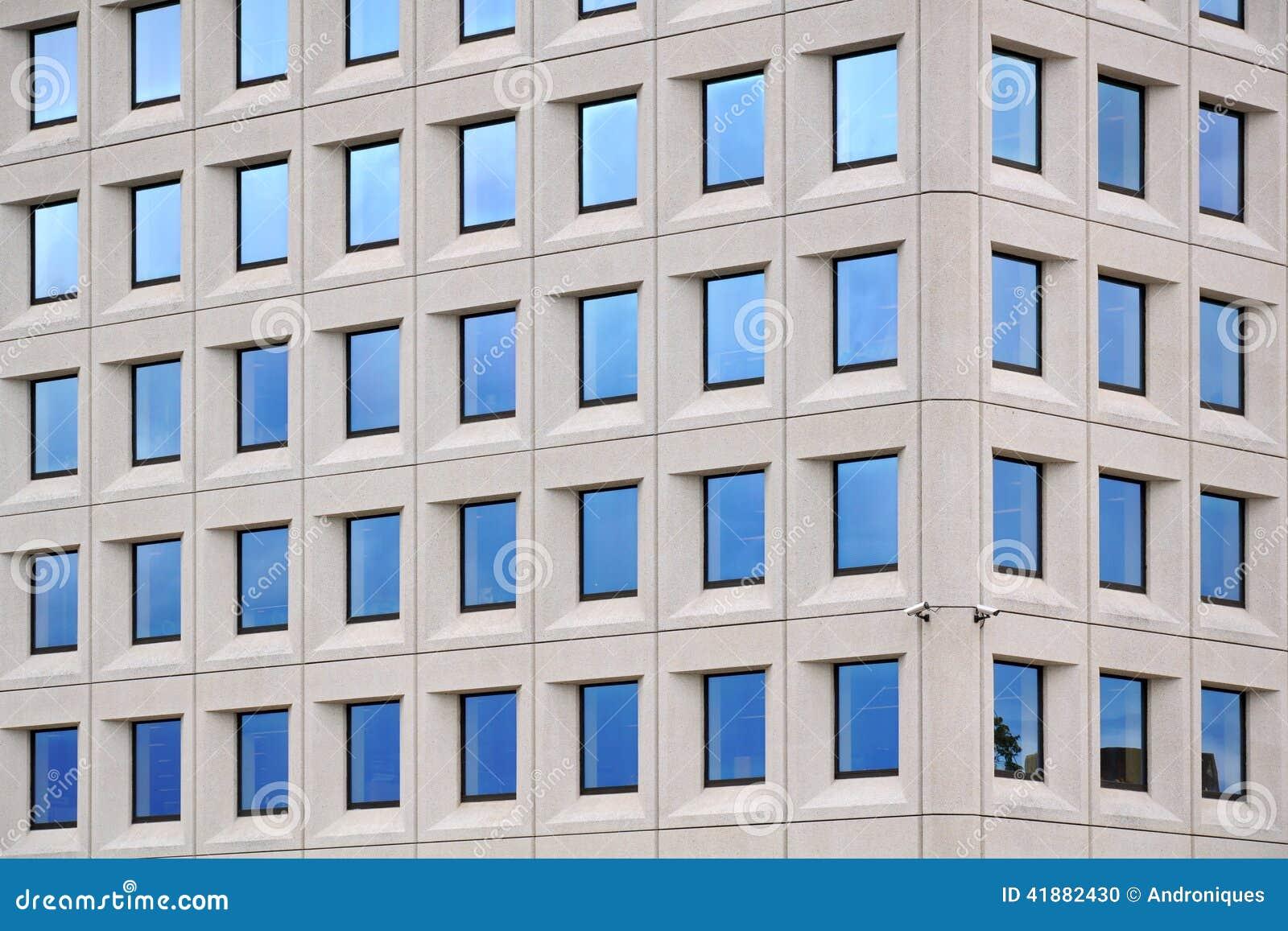 Concrete Building With Windows : Modern concrete building with blue sky windows stock photo