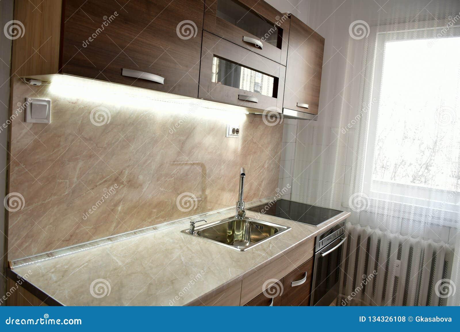 Modern wooden kitchen with lights