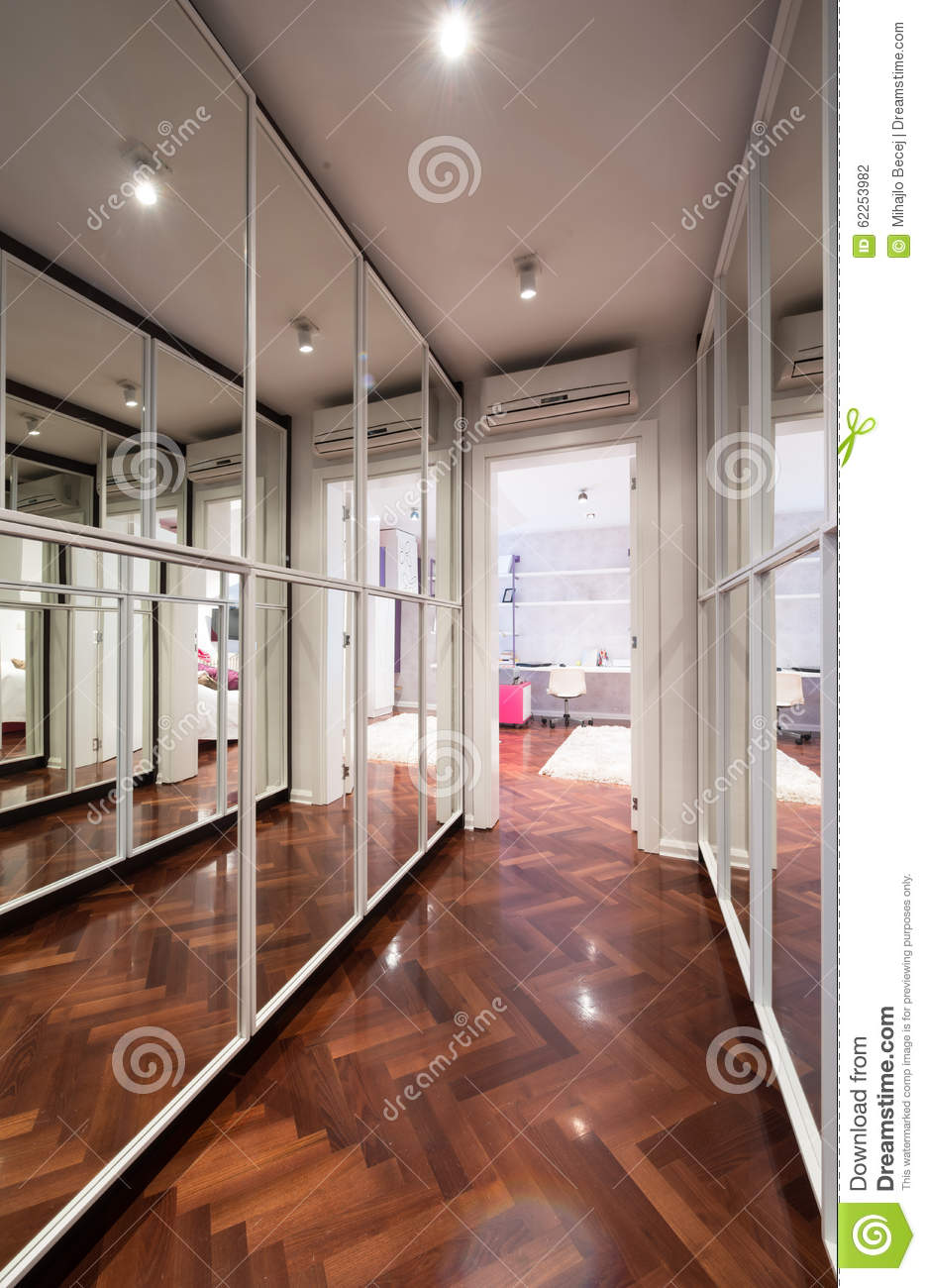 Modern corridor interior with mirror wardrobe doors stock for Armoire couloir design