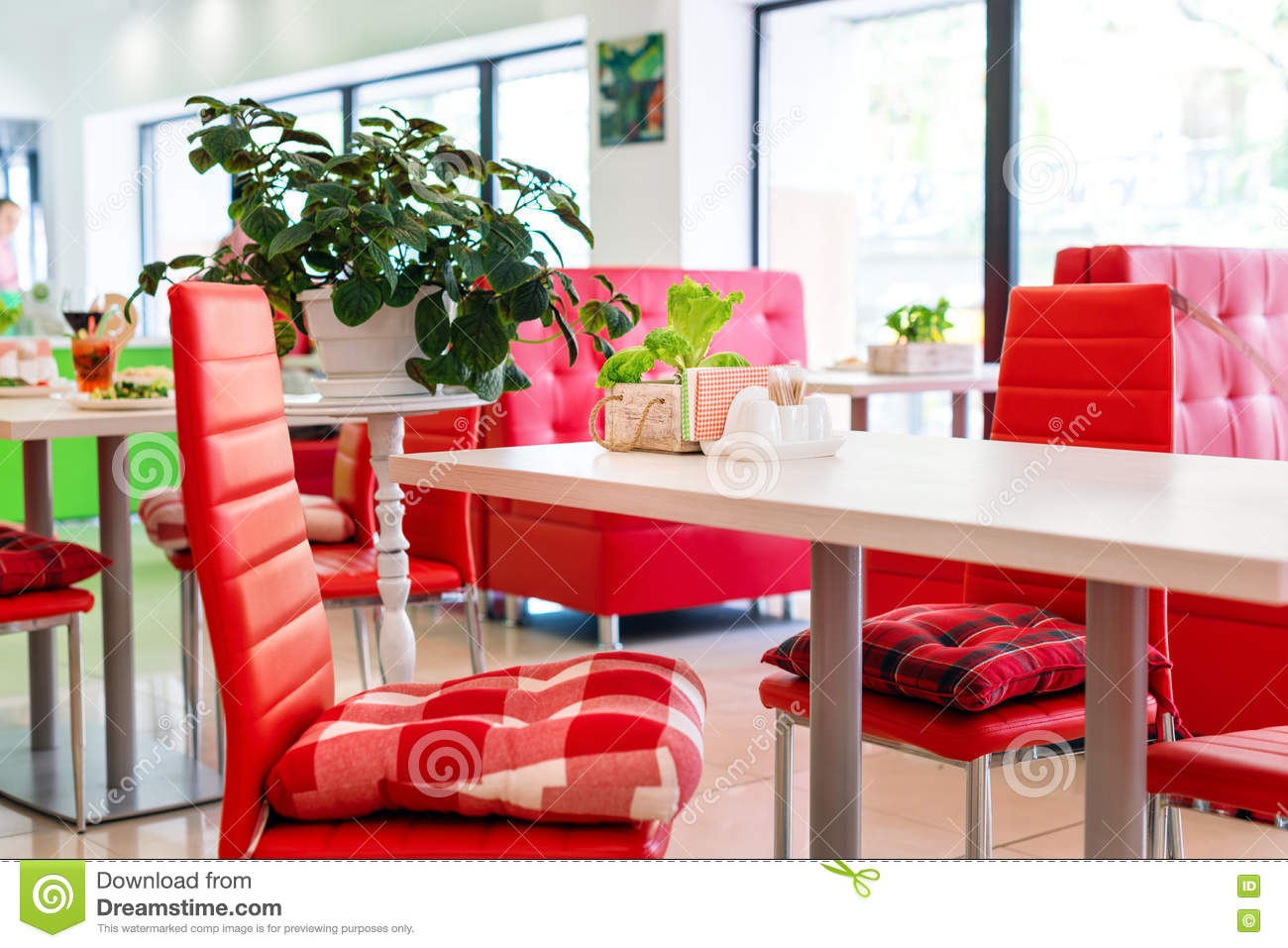 Modern design restaurant interior in white and red colors