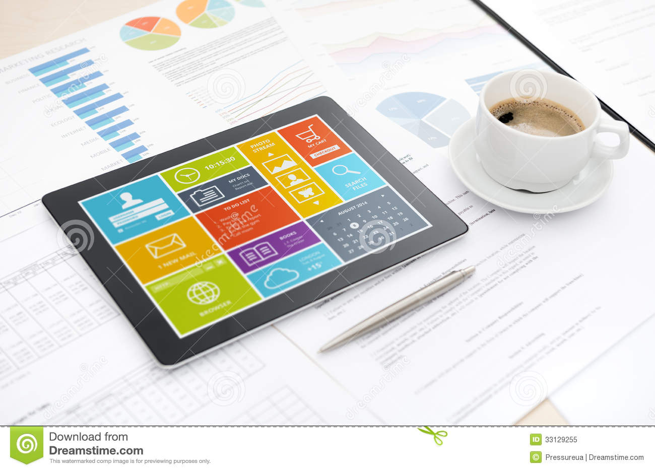 tablet with colorful modern user interface on a screen lying on a desk