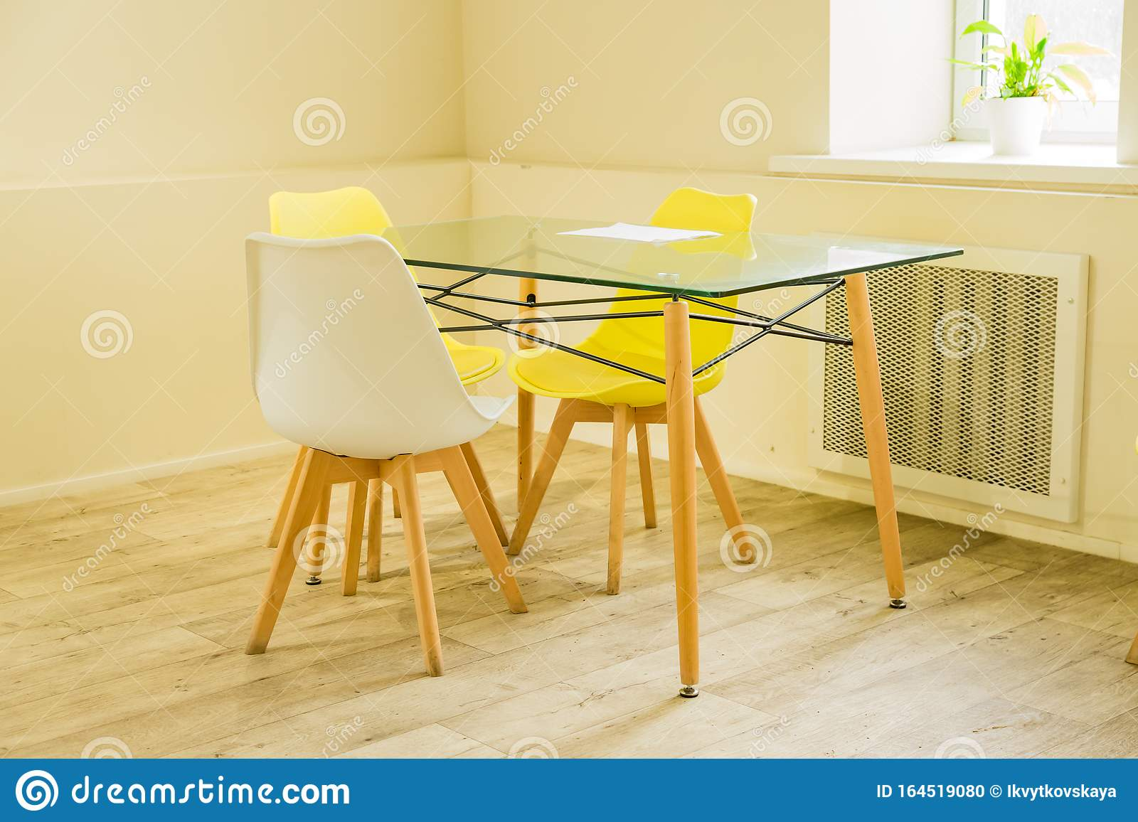 Modern Dining Room Designed In Scandi Style Glass Table And Yellow And White Chairs Stock Photo Image Of Chair Estate 164519080