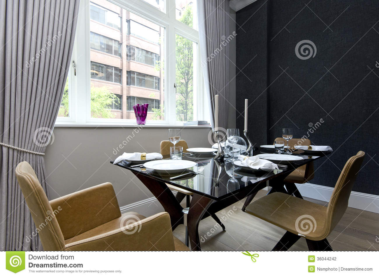Modern dining room with dinner set up for four stock for Best dining room set up