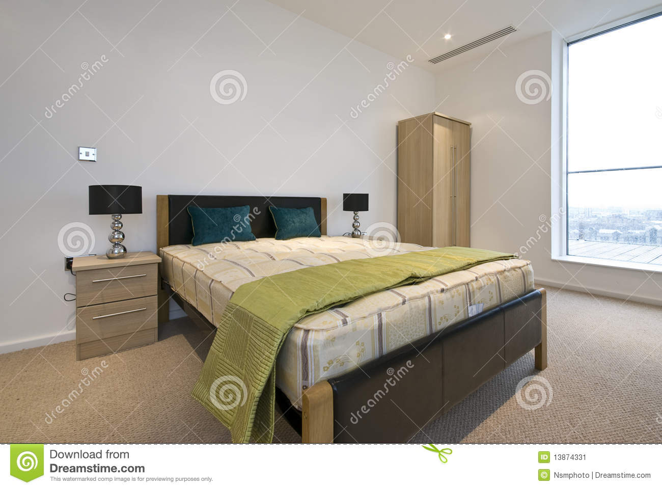 Modern Double Bedroom With King Size Bed Stock Image