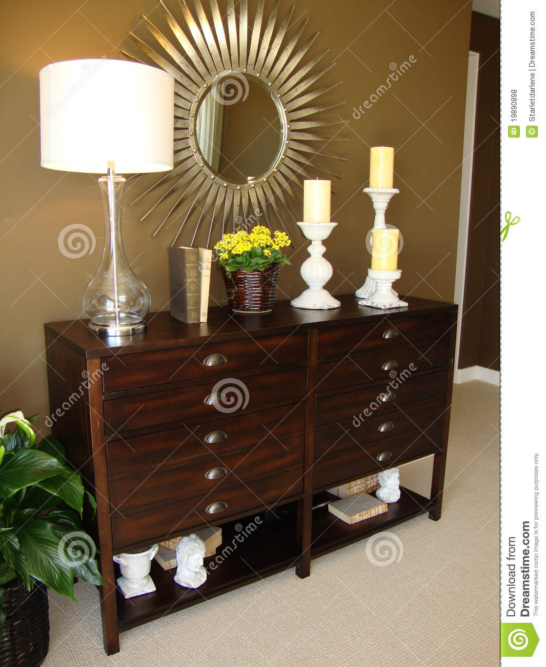 beautiful wood dresser with a lamp and candles and a modern star burst