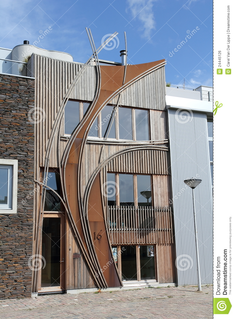 Modern dutch home with wooden curved facade royalty free - Facade de maison provencale ...