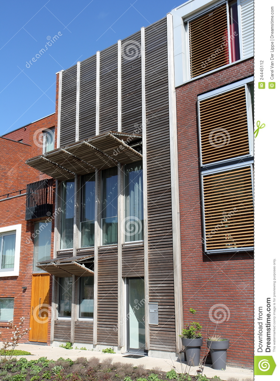 Dutch Curvature Modern House Has A Curved Construction To: Modern Dutch Home With Wooden Curved Facade Royalty-Free
