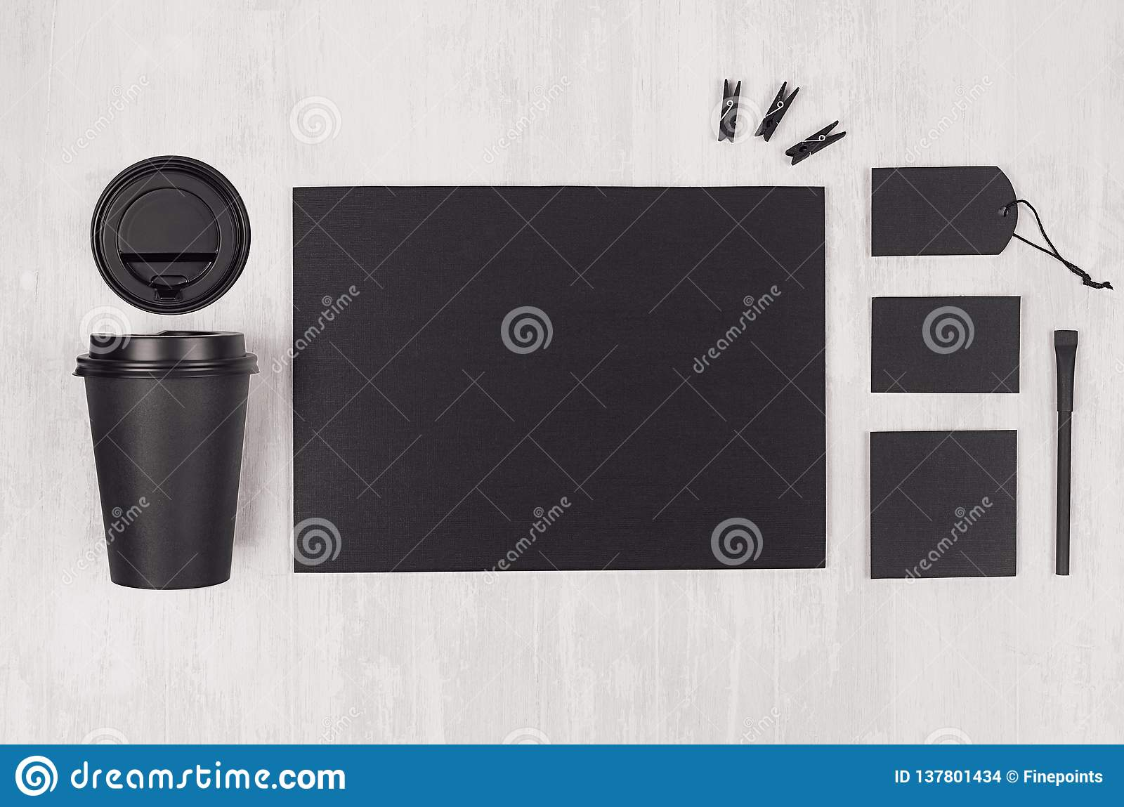 Modern elegance workplace or concept design for restaurant and coffee shop advertising - black paper cup, cap, blank paper.
